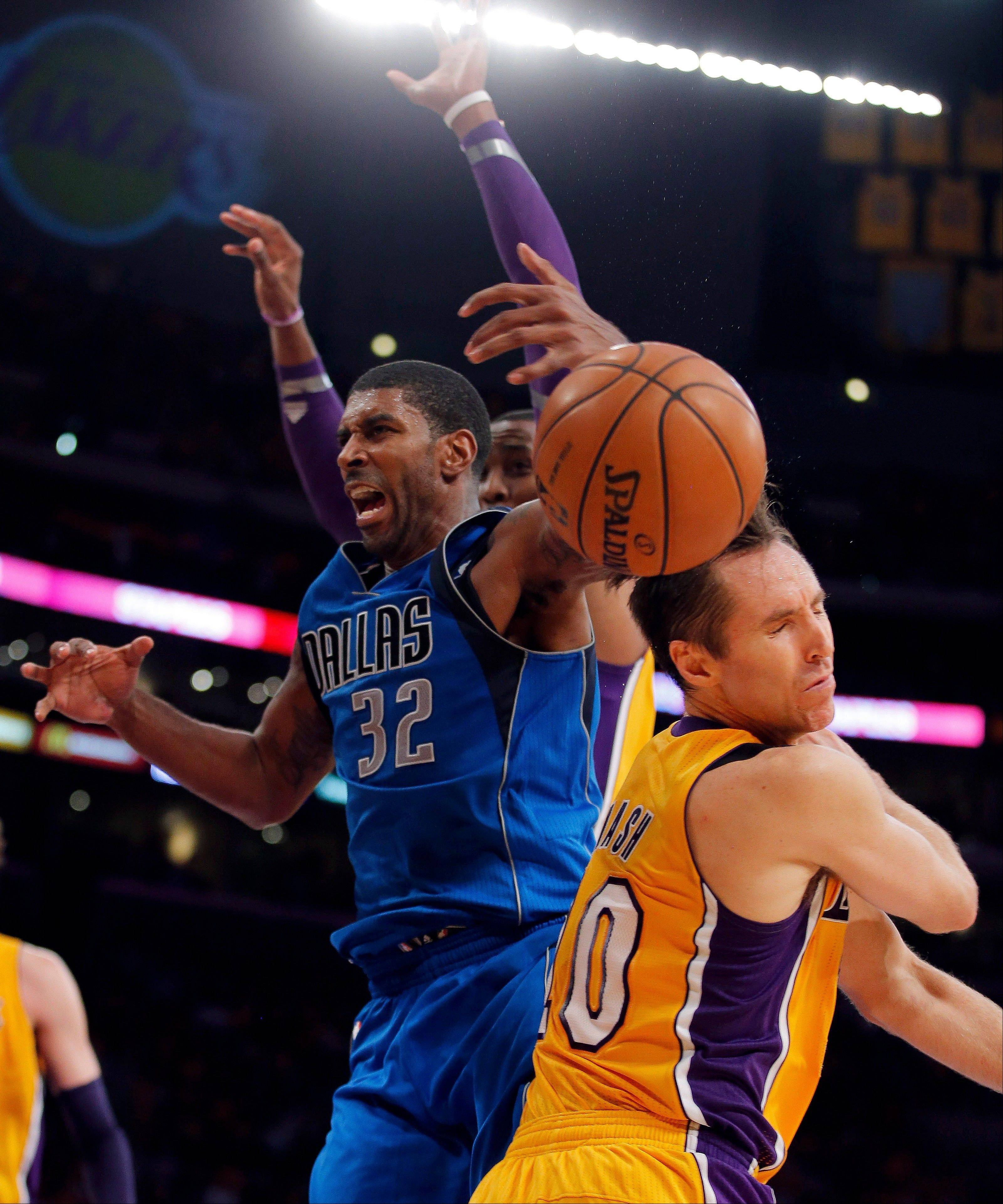 The Dallas Mavericks� O.J. Mayo, center, is fouled by Los Angeles Lakers guard Steve Nash Tuesday during the second half in Los Angeles. The Mavericks won 99-91.