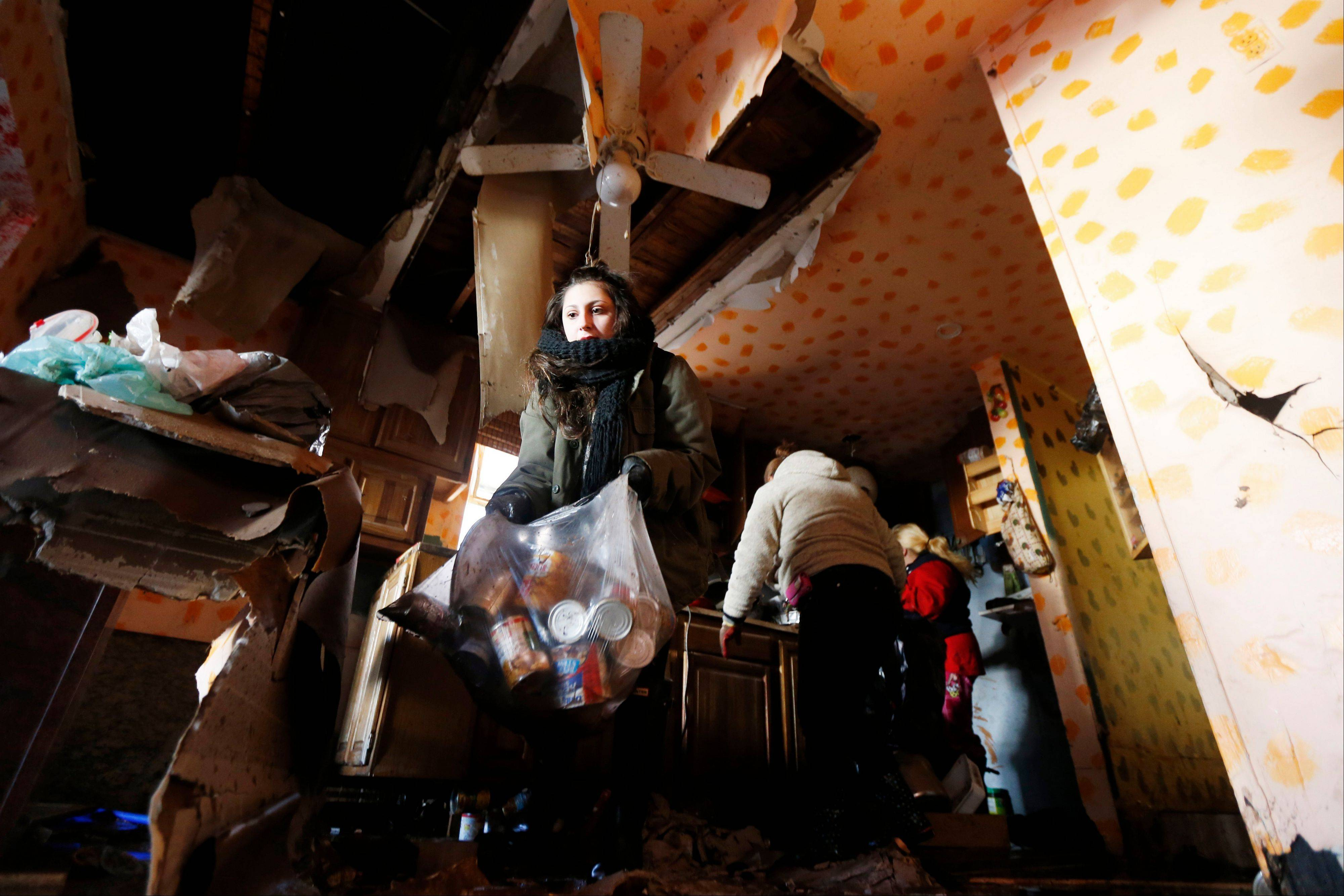 Associated Press Volunteer Christina Wilson, left, helps clean up the kitchen Saturday of the Ventura family, which was flooded during Superstorm Sandy, in Staten Island, N.Y. A Superstorm Sandy relief fund is being created just for residents of the hard-hit New York City borough.