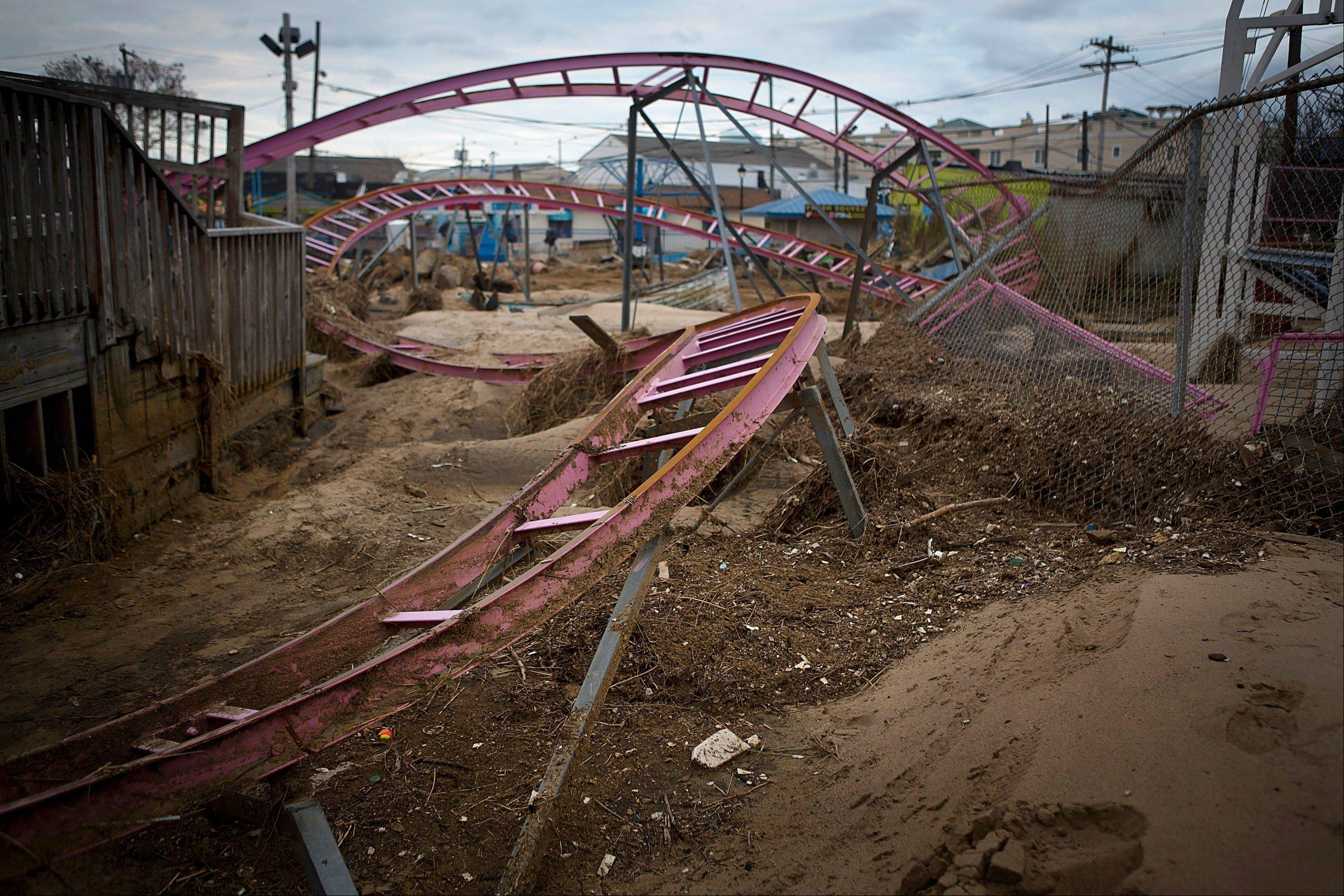 Tracks of a roller coaster sit in the sand Friday at an amusement park in Keansburg, New Jersey.