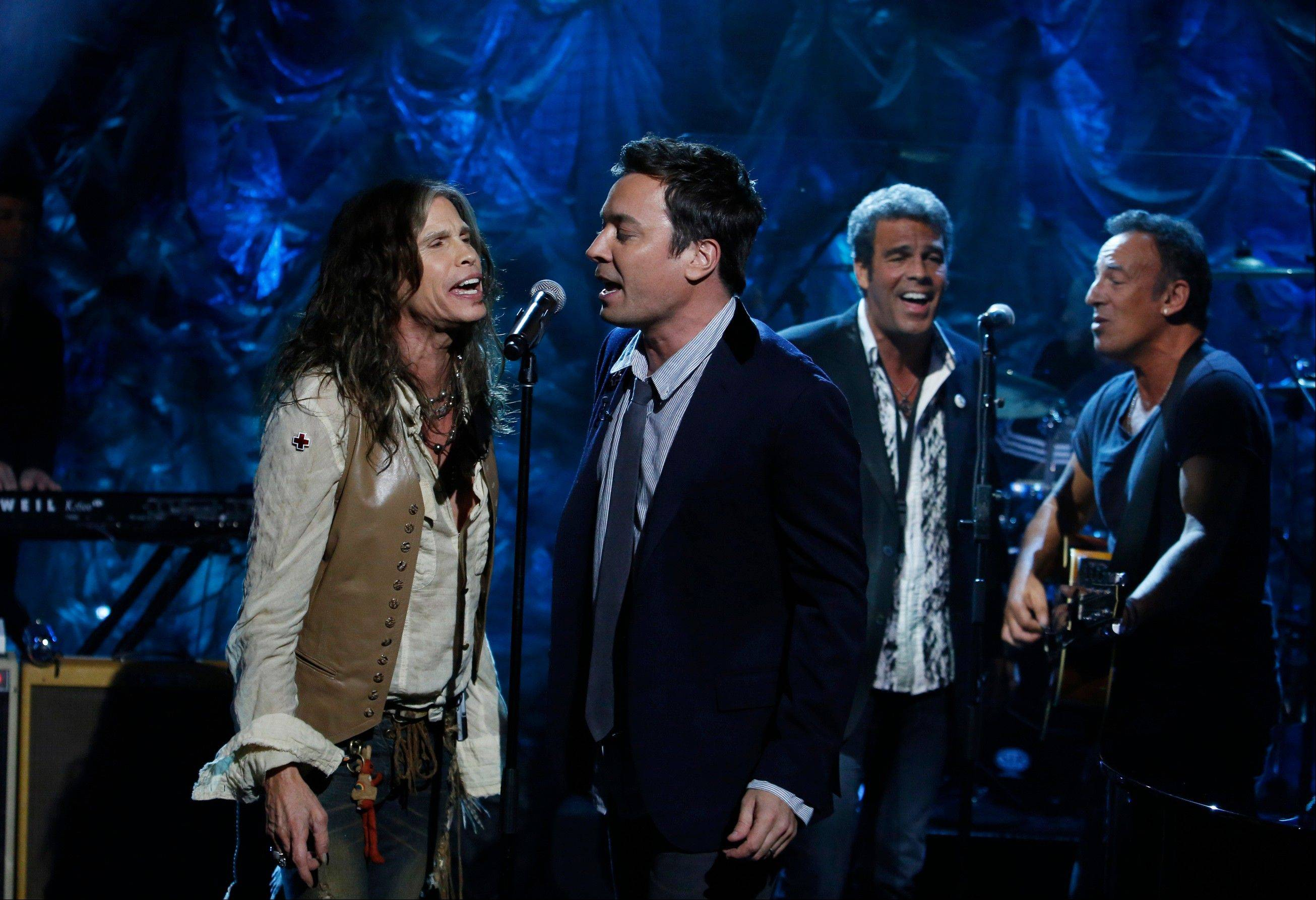 "Steven Tyler, left, Jimmy Fallon, center, and Bruce Springsteen, right, perform during ""Hurricane Sandy: Coming Together"" Friday."