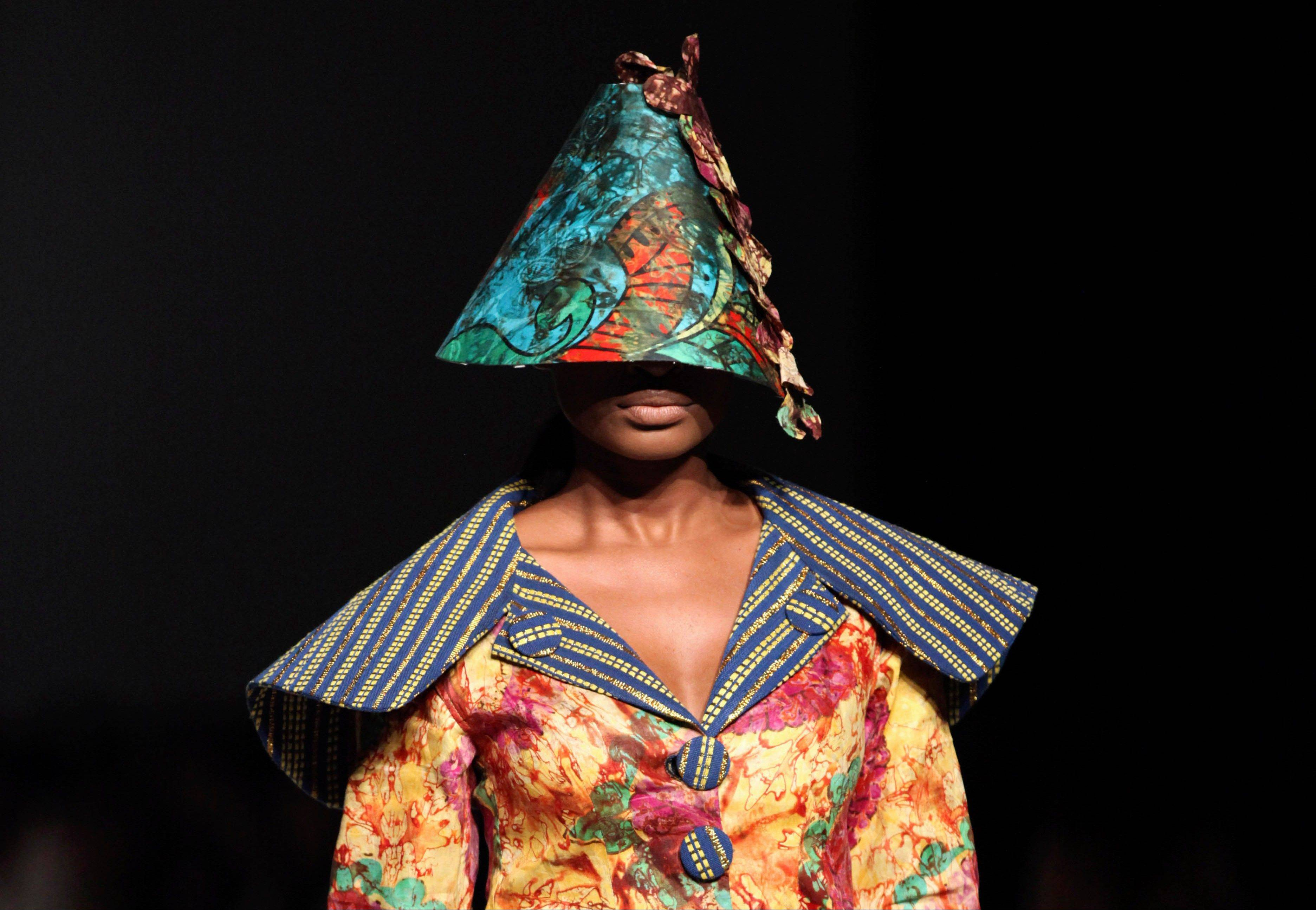 A model displays a creation by designer Weizdhurm Franklyn, during the MTN Fashion and Design Week in Lagos, Nigeria, Saturday, Oct. 27, 2012.