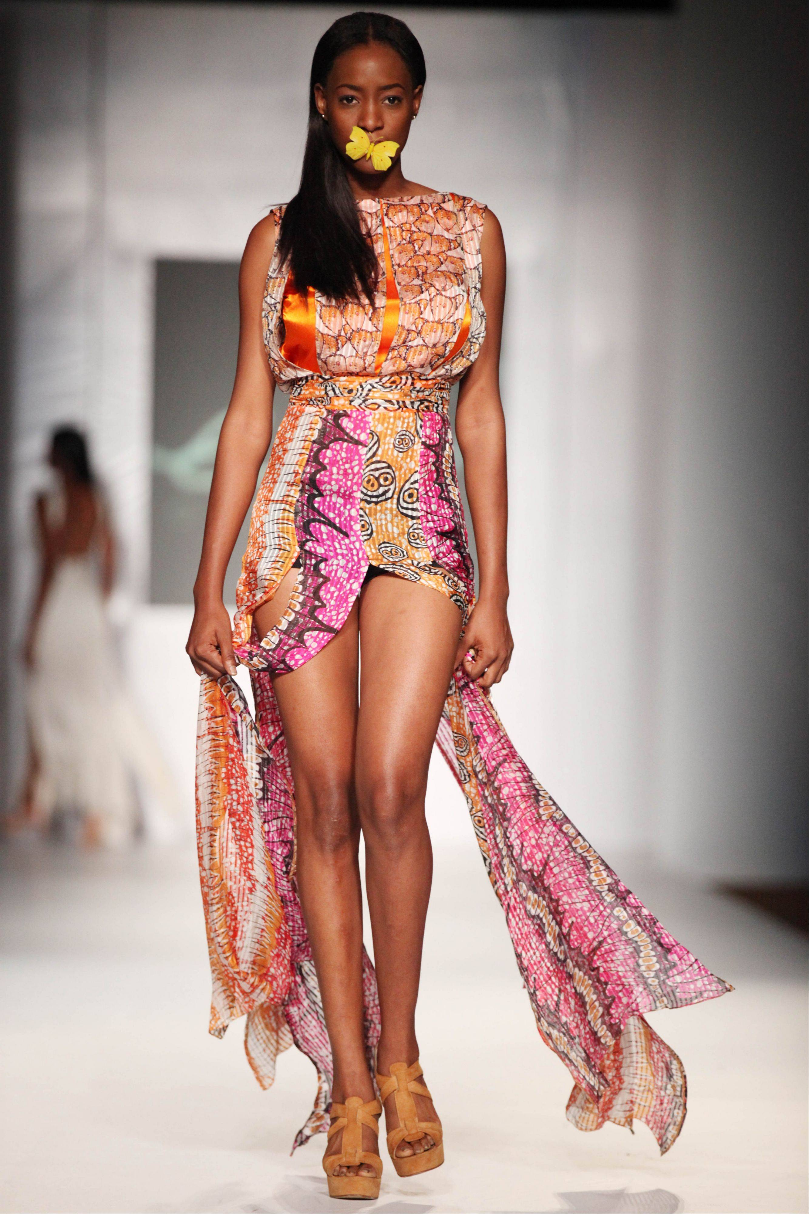 A model shows a creation by designer Eki Orleans during the MTN Fashion and Design Week in Lagos, Nigeria, Friday, Oct. 26, 2012.