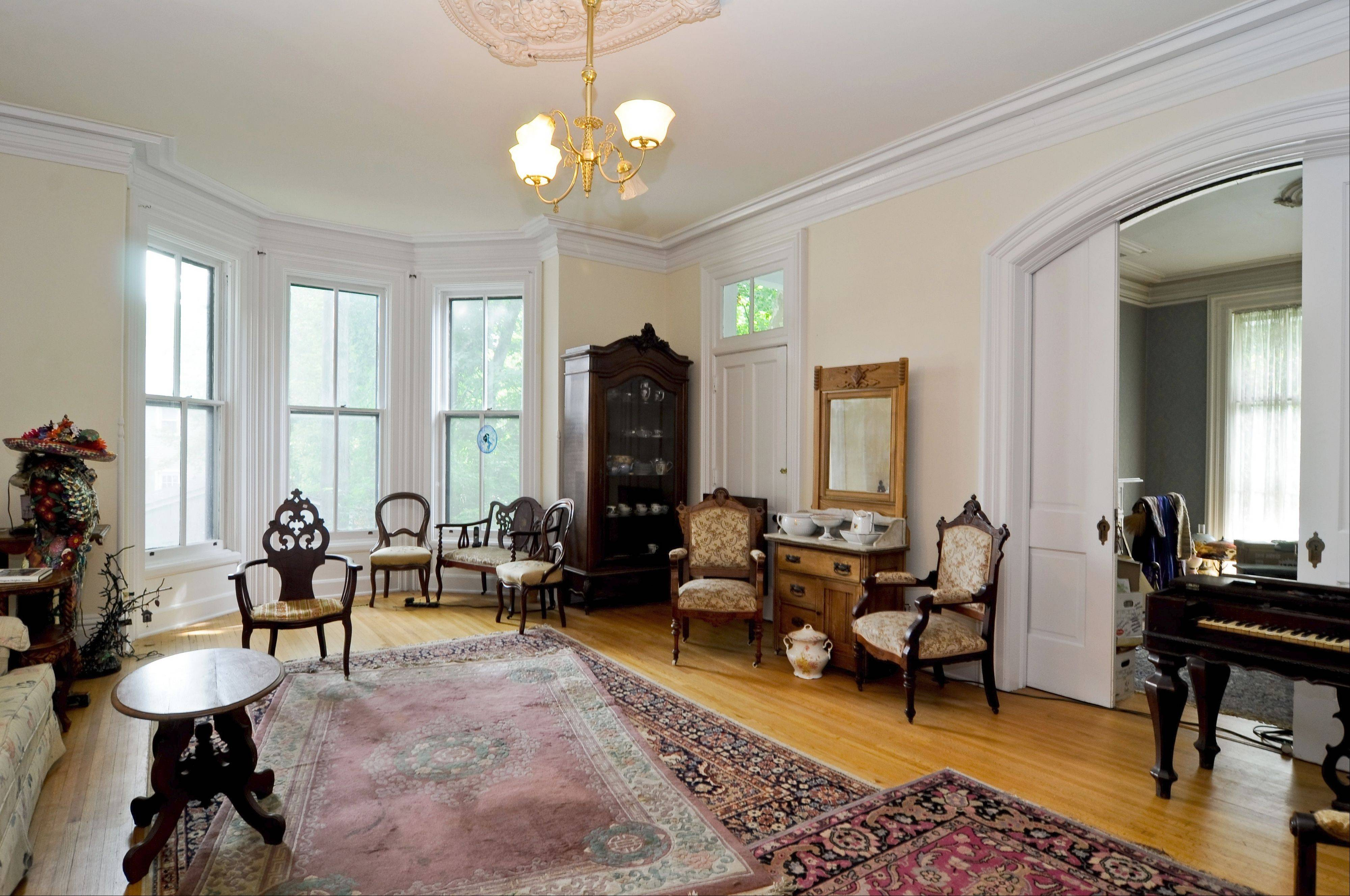 Arched pocket doors in the living room are original to the home, built in 1871.