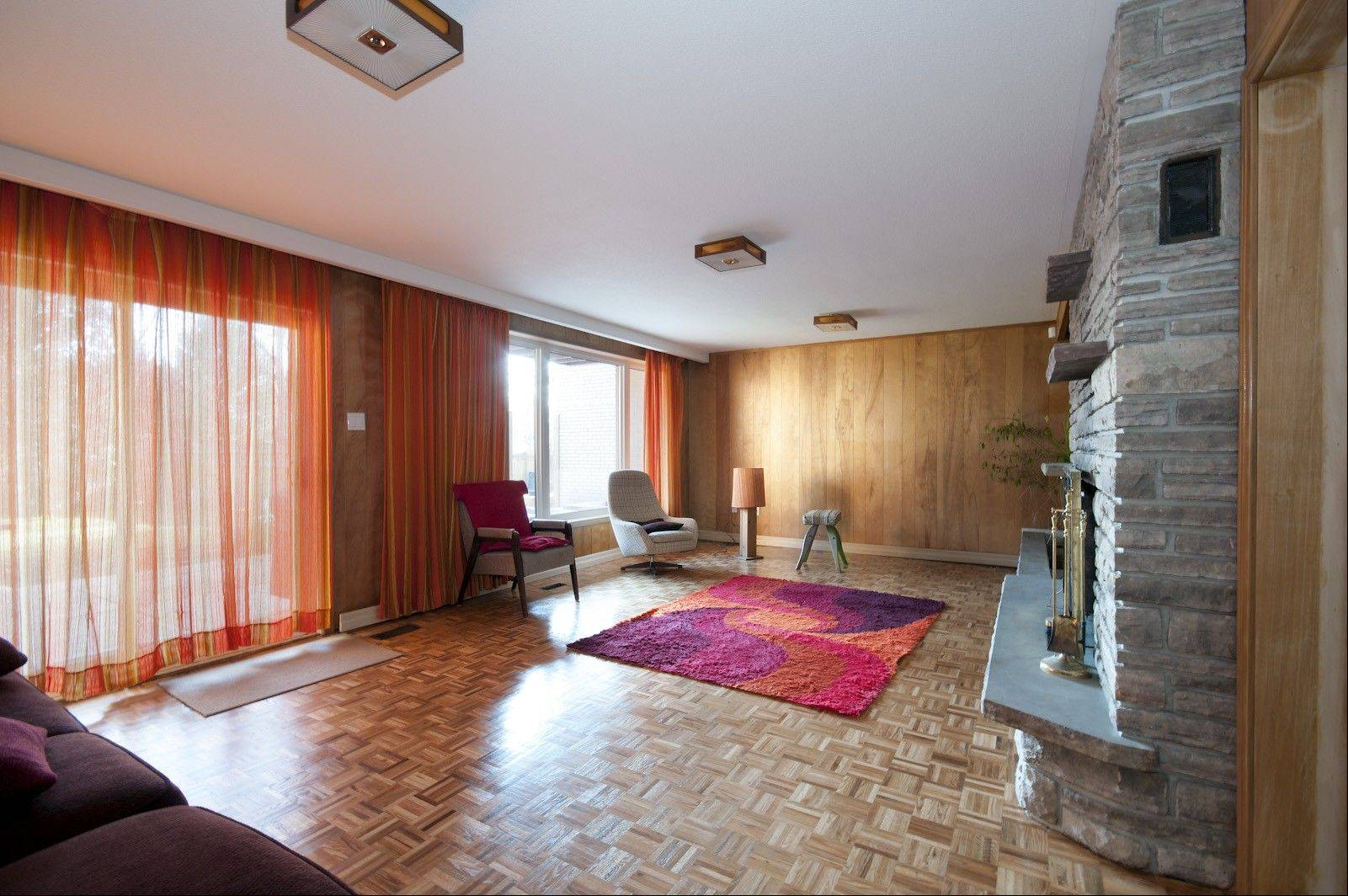 This space was a well-preserved relic of the 1960s, complete with pristine parquet flooring, popcorn ceiling, wood paneling and orange shag rugs and curtains.