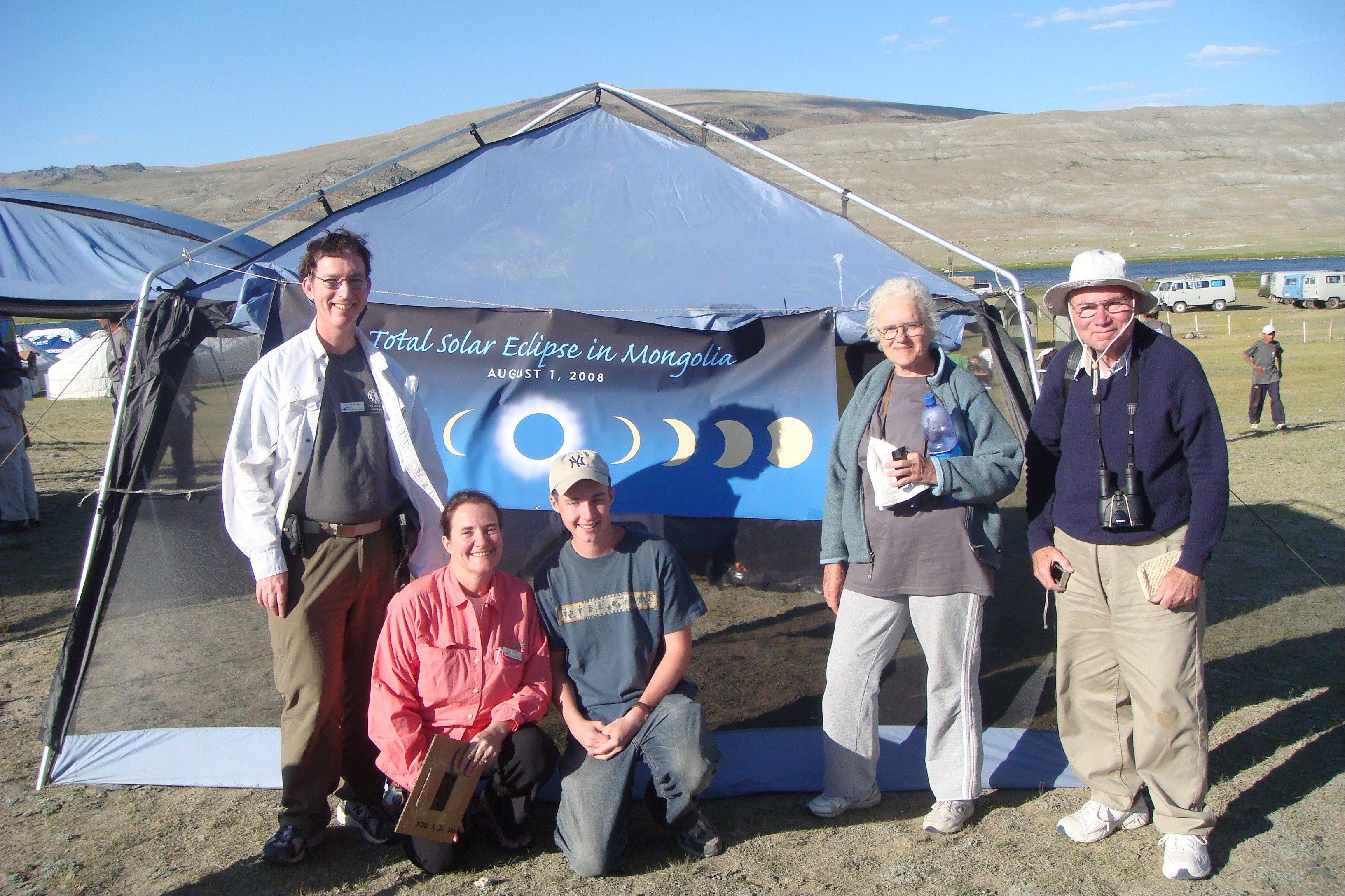 George Bugbee, left, Diane Bugbee and Dali and Eli Maor, in Mongolia where they had traveled to watch a solar eclipse. The Bugbees are traveling to watch their fourth solar eclipse on Nov. 14 in Cairns, Australia.