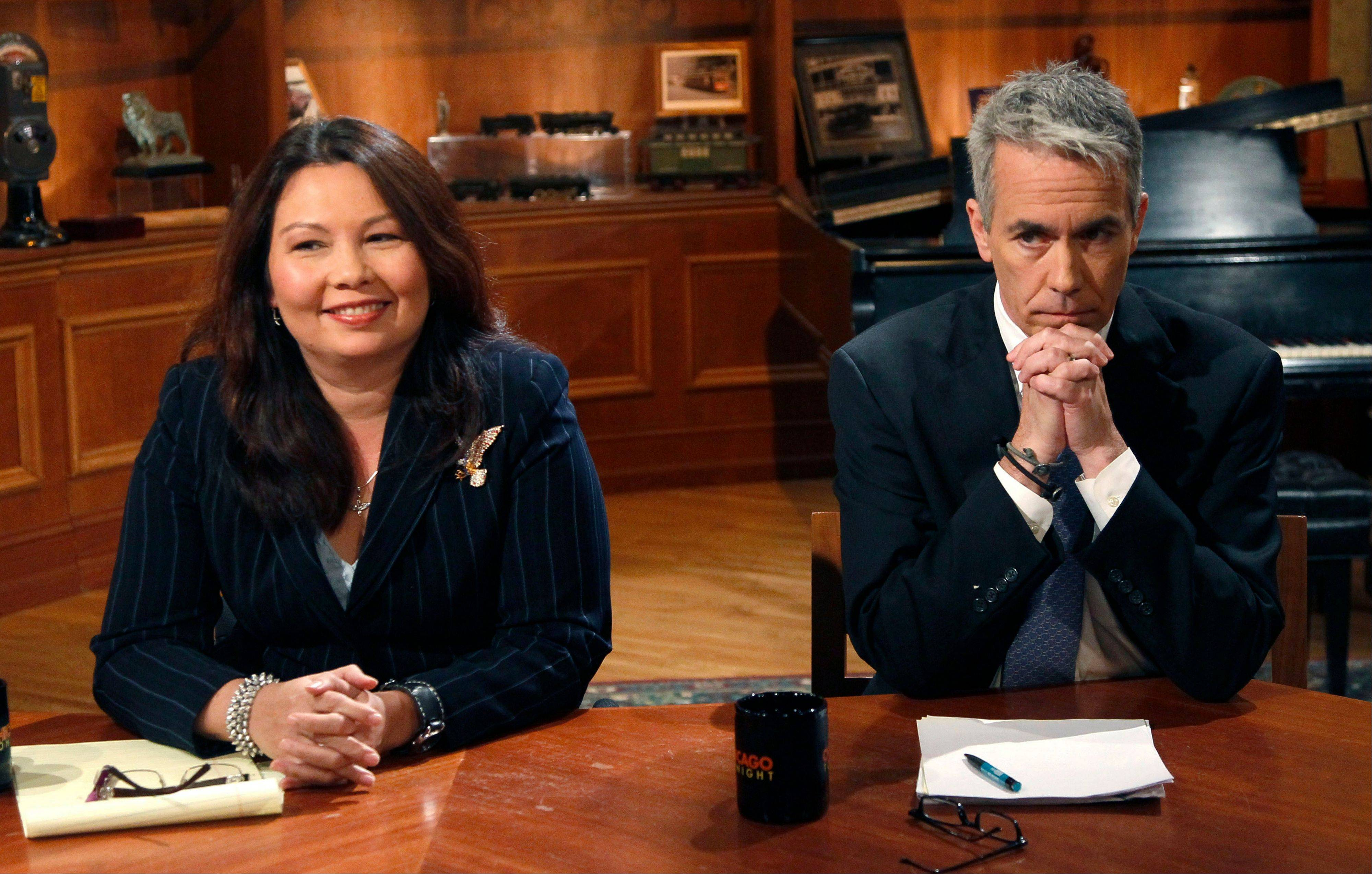 Republican U.S. Rep. Joe Walsh, right, and challenger Democrat Tammy Duckworth before a televised debate at the WTTW studios Thursday, Oct. 18, 2012, in Chicago.