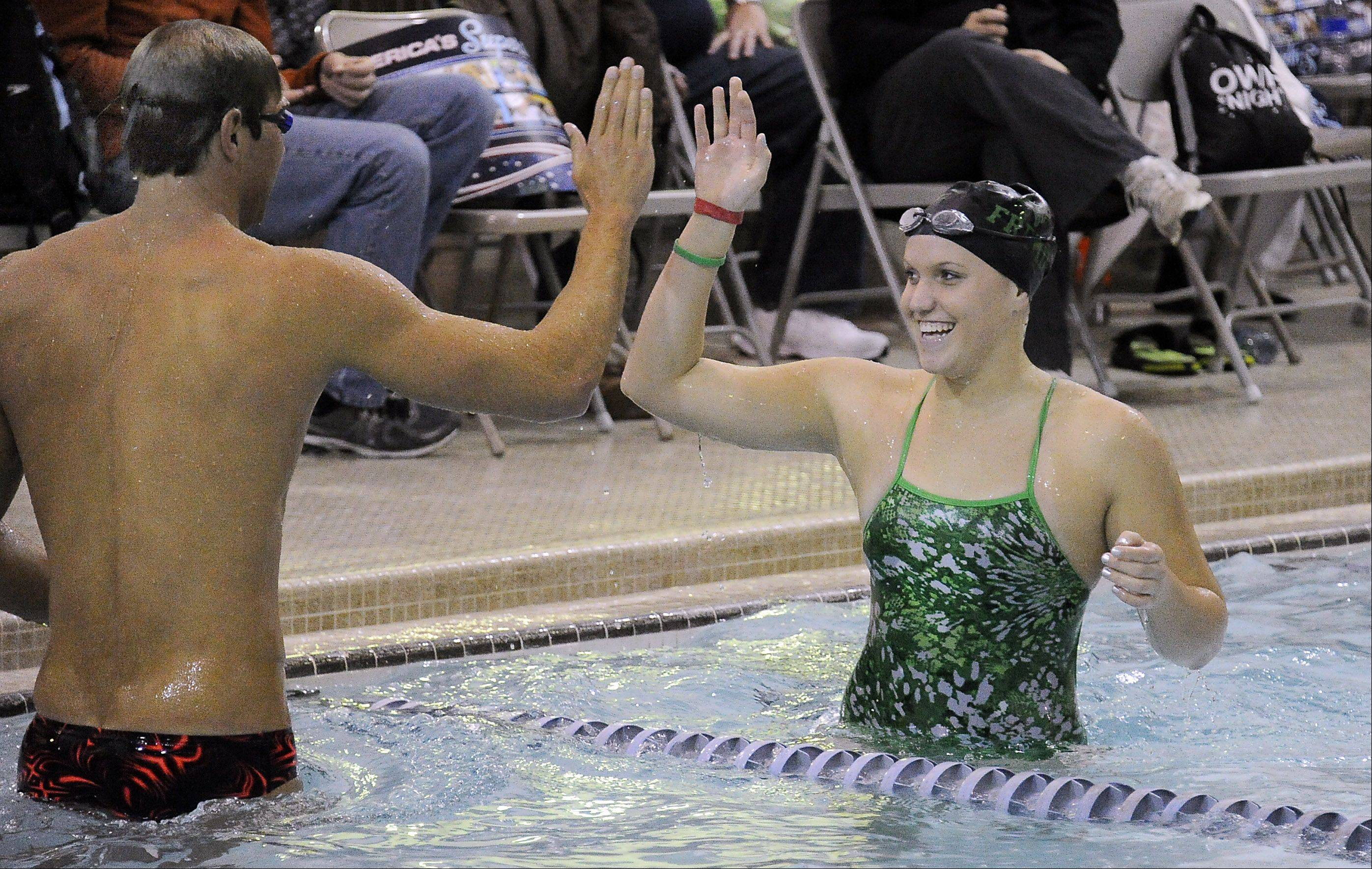 Olympic gold medalist Matt Grevers gives a high-five to Breanna Anderson, 17, of Palatine, during a swimming clinic at Buehler YMCA in Palatine on Saturday.