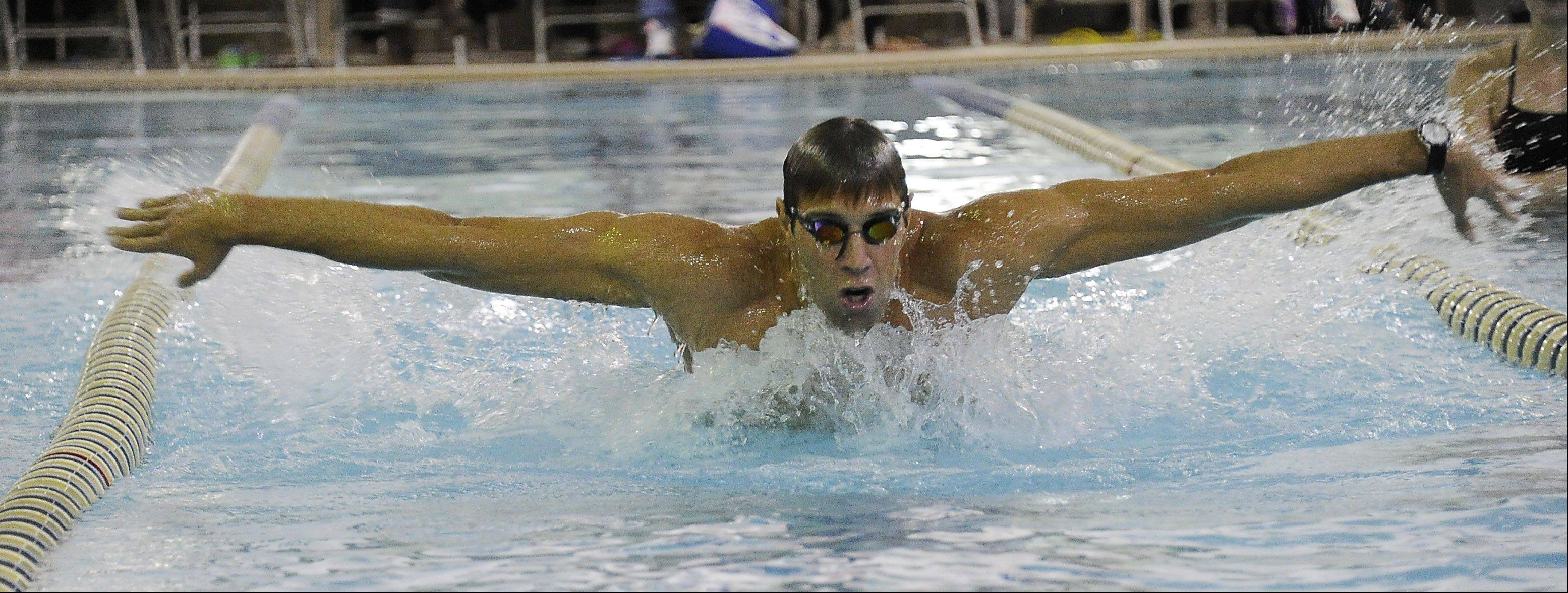 Olympic gold medalist Matt Grevers displays his butterfly skills during a swimming clinic for youngsters at Buehler YMCA in Palatine on Saturday.