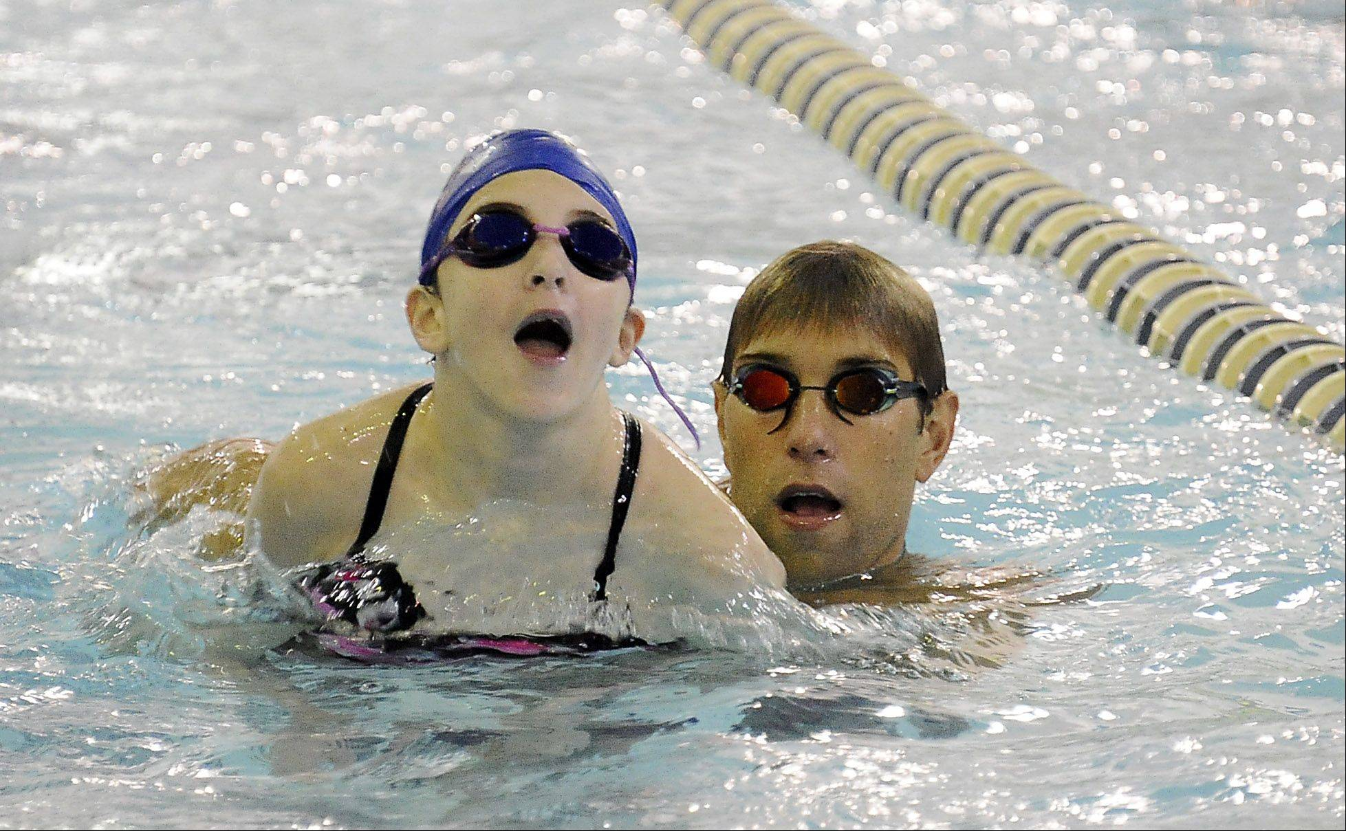 Olympic gold medalist Matt Grevers gives personal instructions to Megan Silva, 11, of Palatine during a swimming clinic at Buehler YMCA on Saturday.