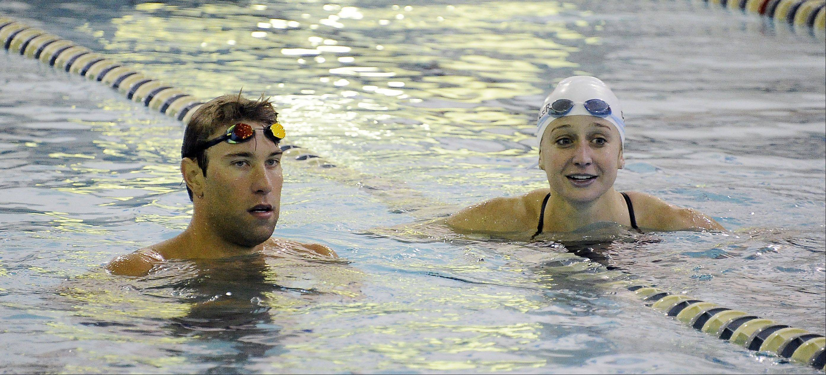 Olympic gold medalist Matt Grevers, with his fiancee Annie Chandler, gives personal instruction to the dozens of kids who attended his swimming clinic at Buehler YMCA on Saturday.