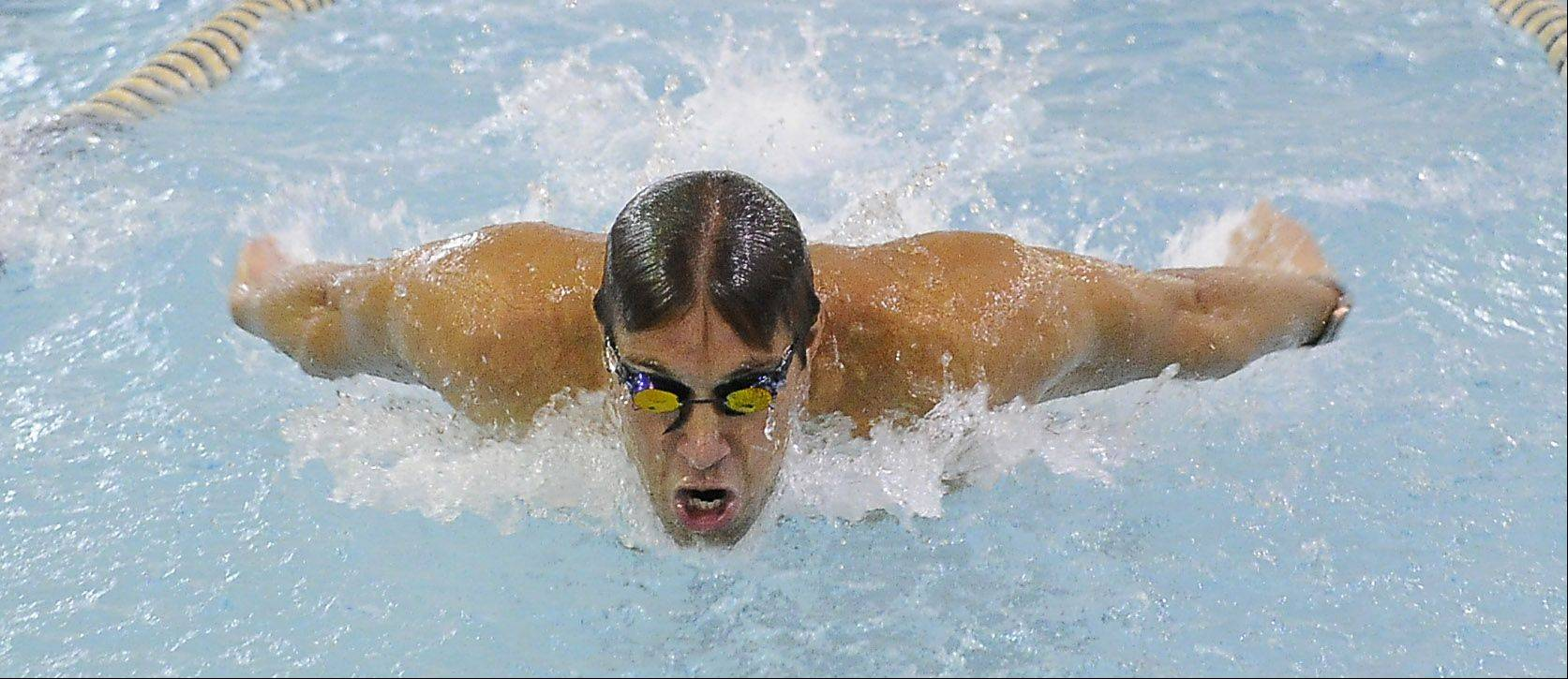 Olympic gold medalist Matt Grevers displays his butterfly skills during his swimming clinic at the Buehler YMCA on Saturday.