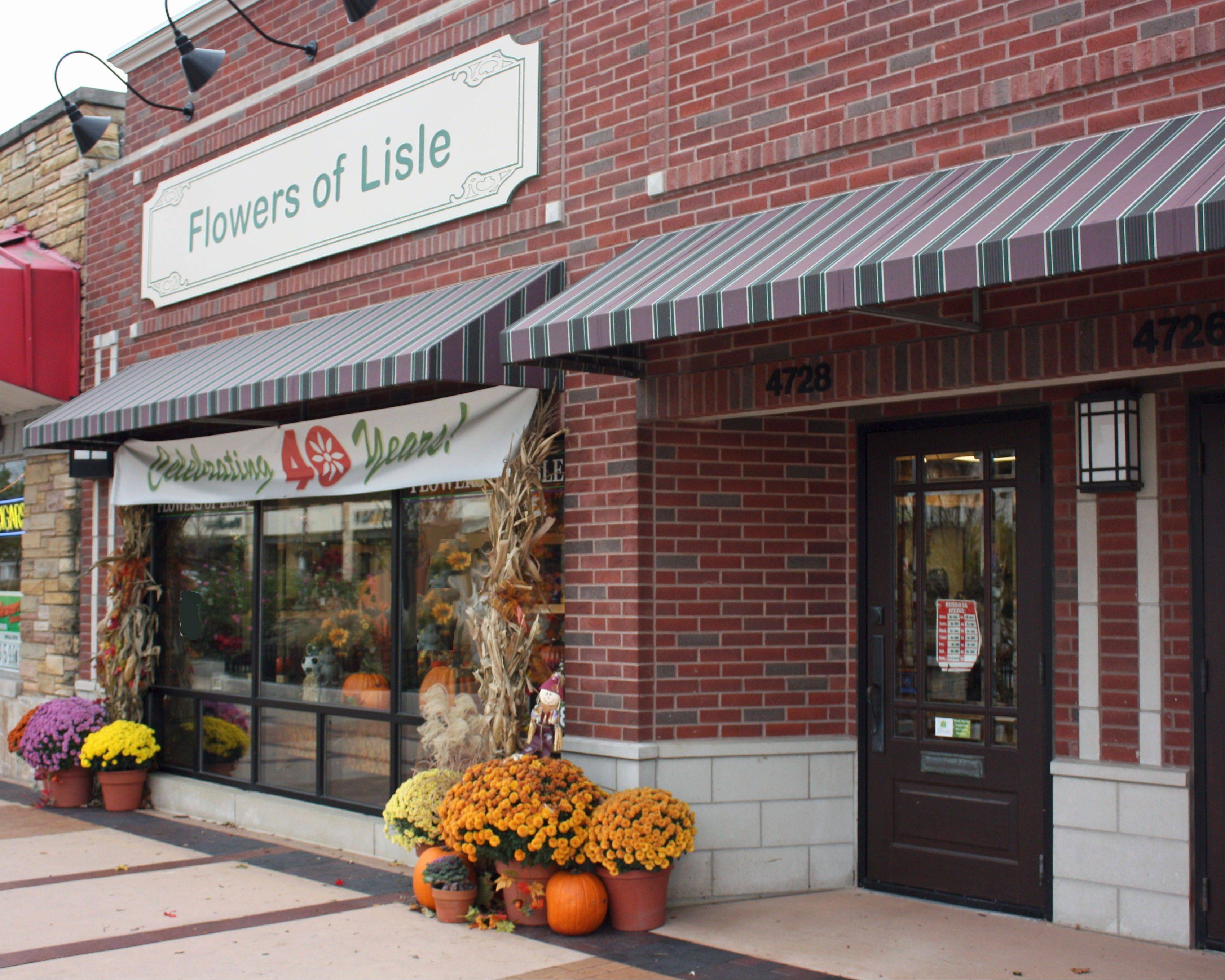 The facade of Flowers of Lisle has changed over the years, but it's been a mainstay of Main Street for 40 years.