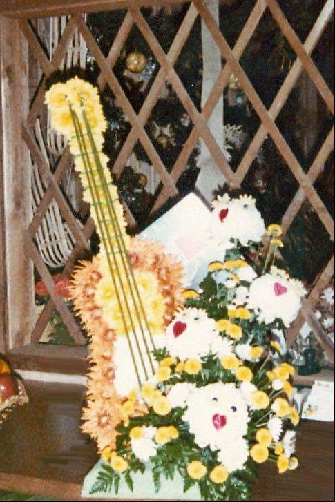 Designers at Flowers of Lisle sometimes are asked to make some unusual creations, such as the guitar arrangement for the wake of a musician.