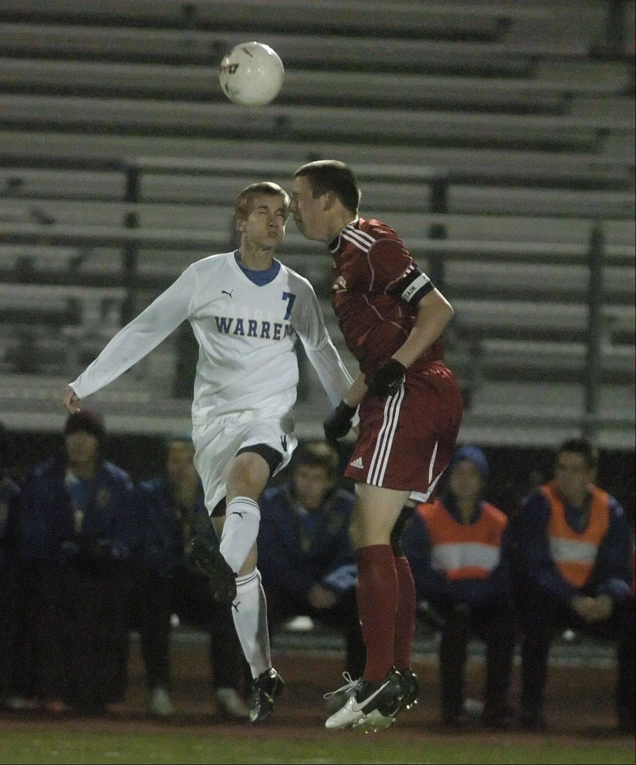 Nick Wegrzynowicz,left, of Warren and Drake Swope of Naperville go up for a header during the Warren vs. Naperville Central Class 3A state final in Frankfort on Saturday.
