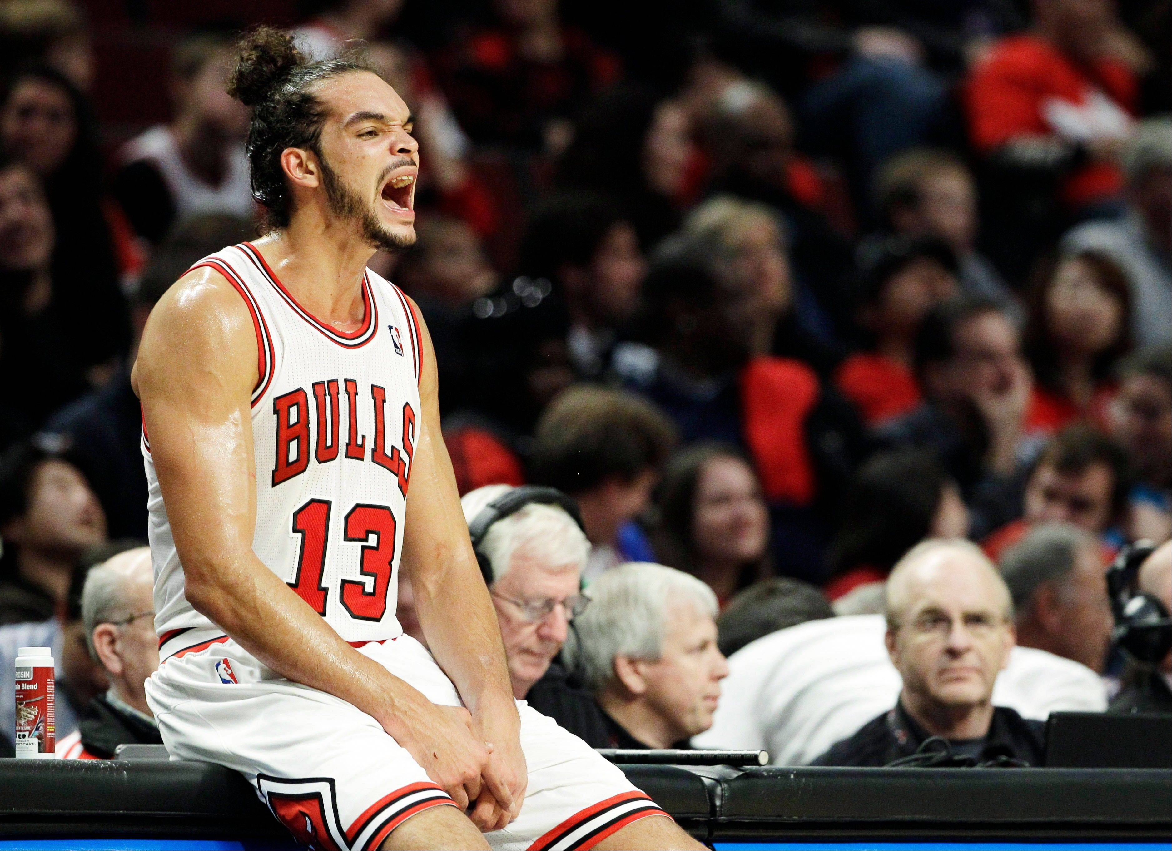Bulls center Joakim Noah (13) yells to his team during the second half of an NBA basketball game against the New Orleans Hornets in Chicago, Saturday, Nov. 3, 2012. The Hornets won 89-82.