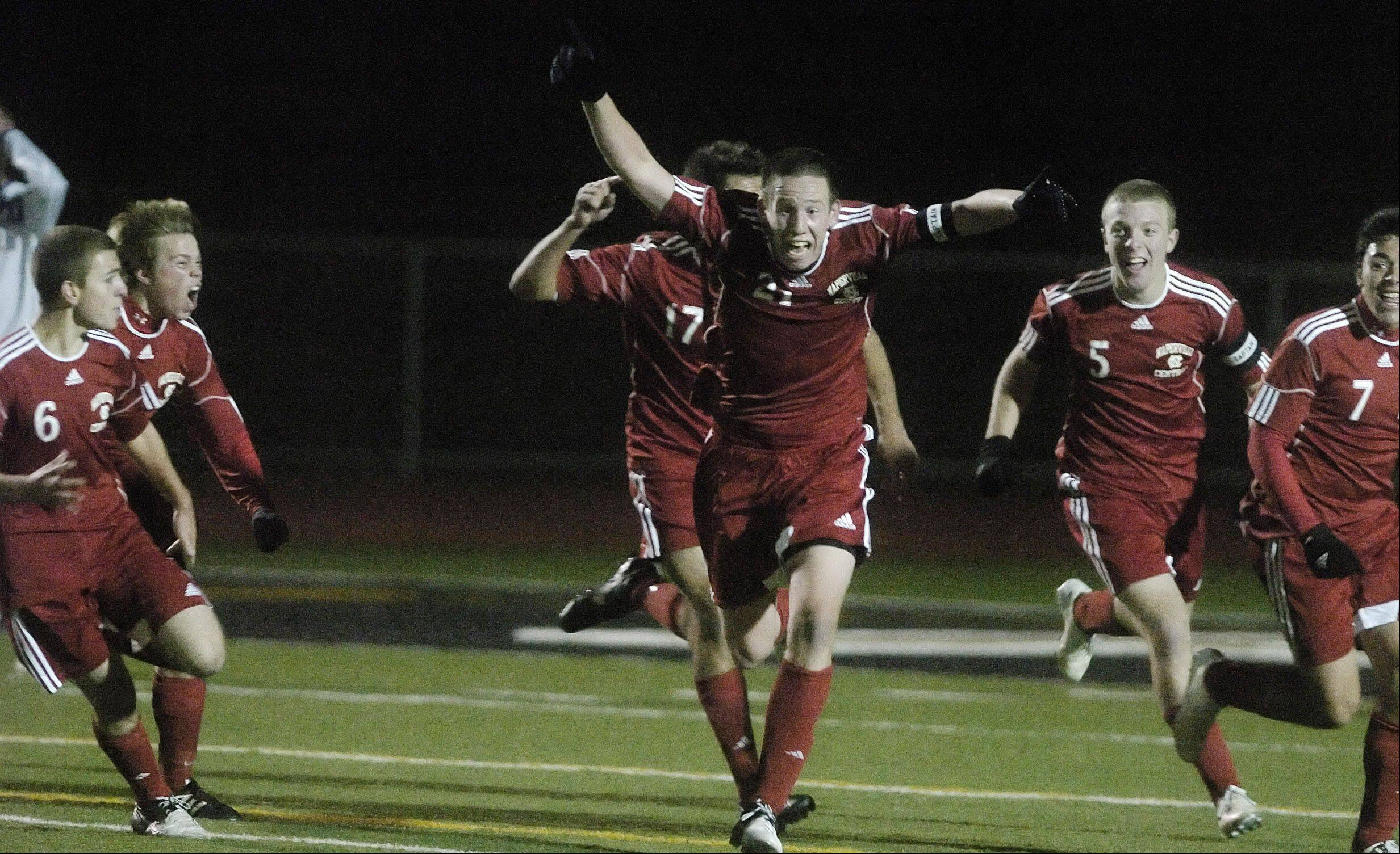 Jack Patrick of Naperville Central celebrates scoring a goal that tied the game during the Warren vs. Naperville Central Class 3A State Final in Frankfort Saturday.