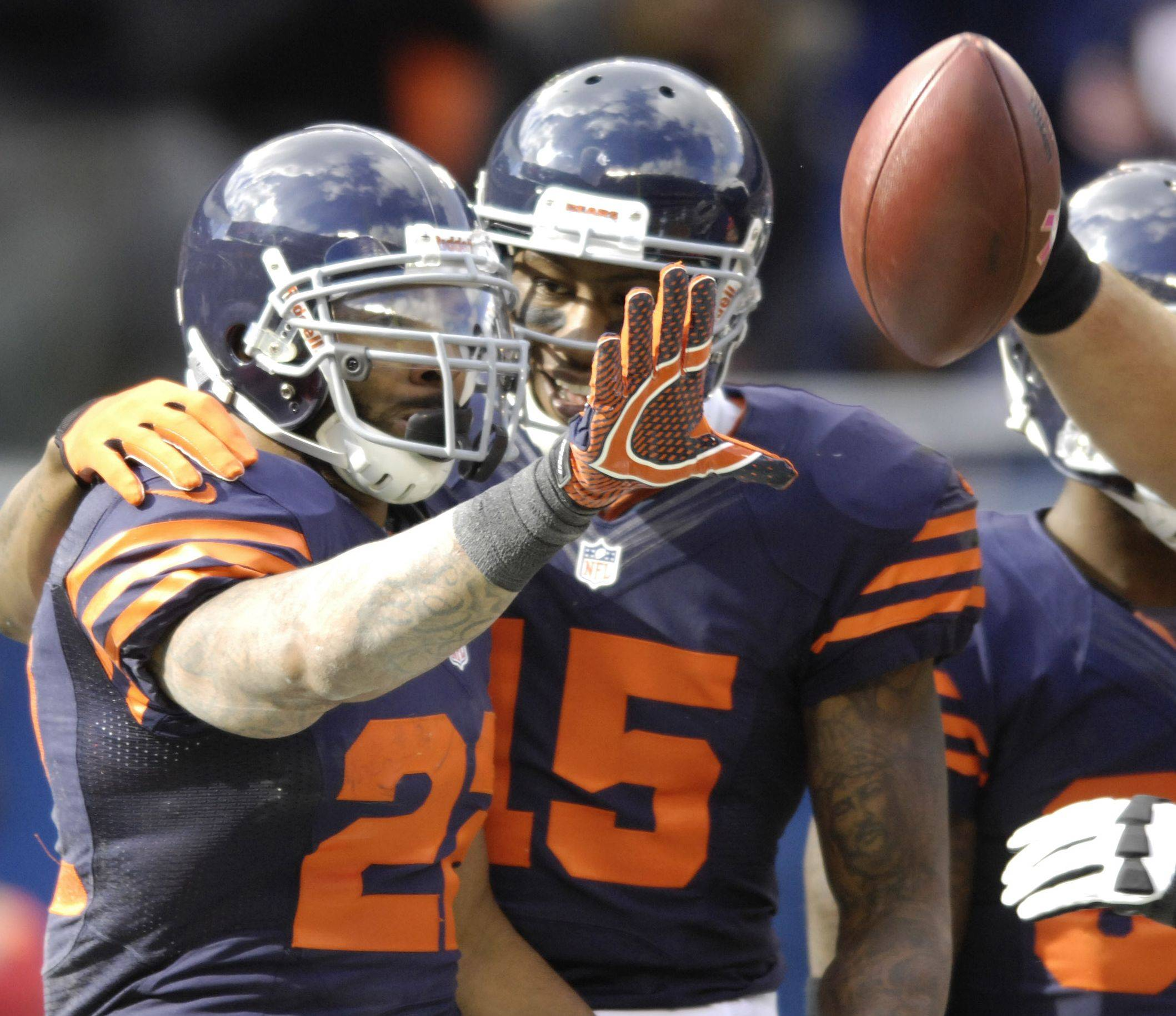 Matt Forte, left, celebrtes his touchdown run with Brandon Marshall against Carolina last Sunday. After seven games, Forte's numbers are down this year compared to 2011.