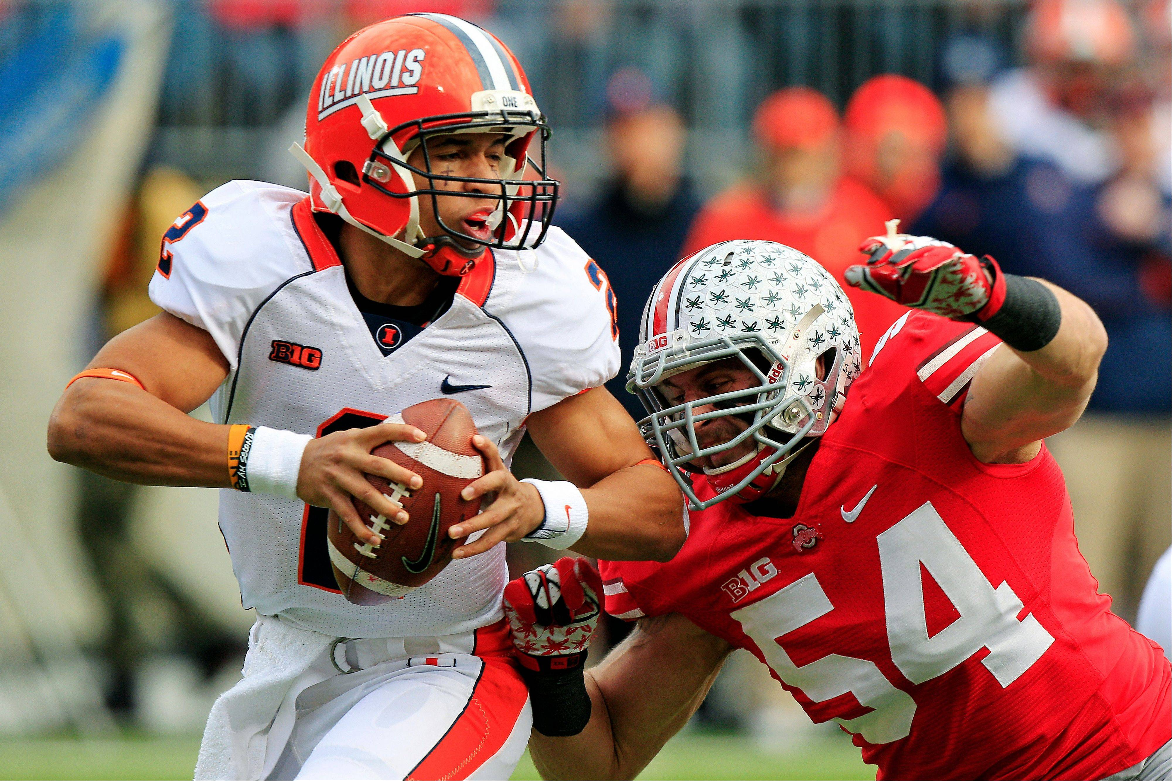 Illinois quarterback Nathan Scheelhaase, left, is sacked by Ohio State defensive lineman John Simon Saturday during the first quarter in Columbus, Ohio.