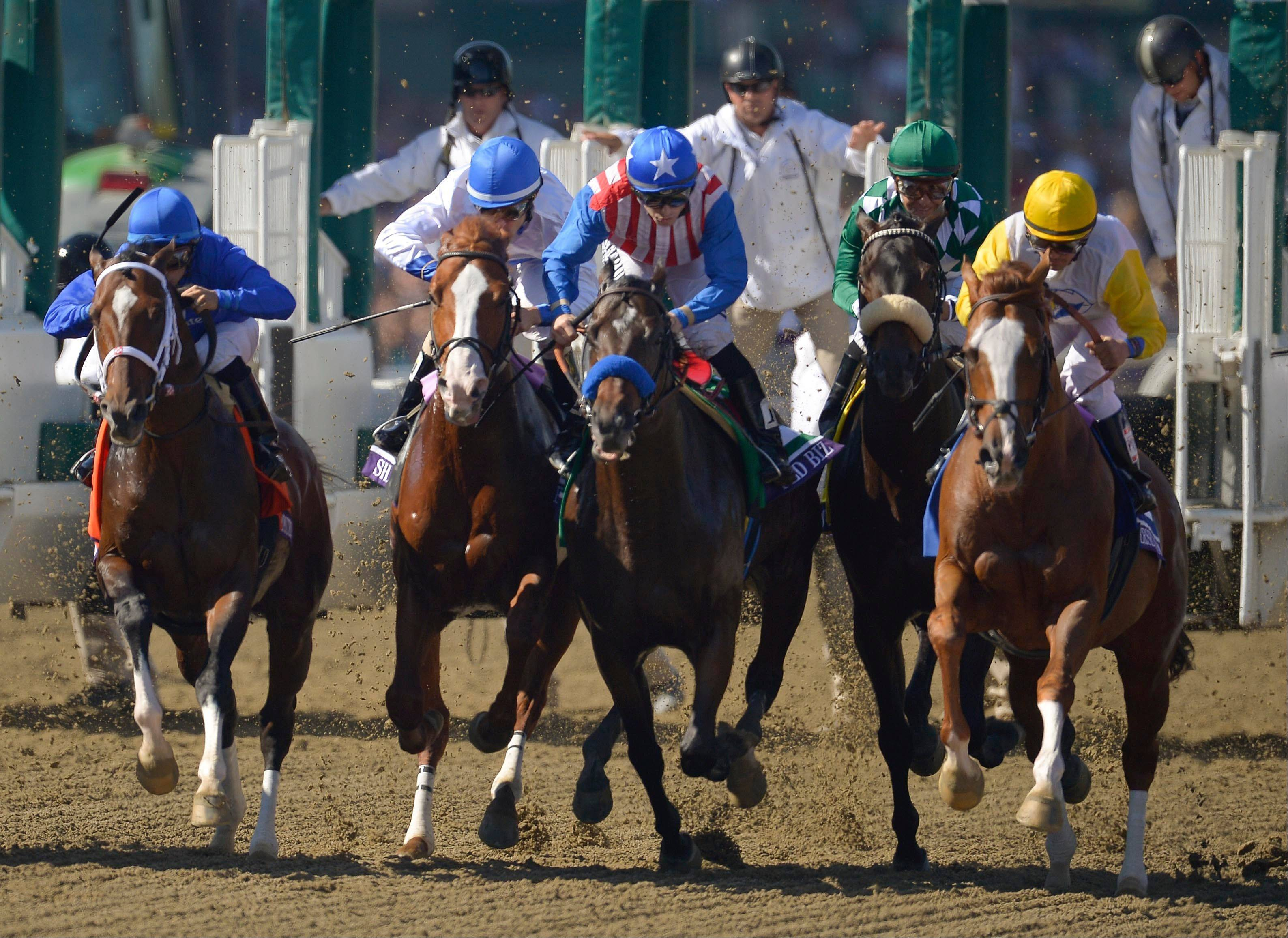 From left, Emcee, Shackleford, Fed Biz, John Scott and Jersey Town, break from the starting gate Saturday in the Breeders' Cup Dirt Mile race at Santa Anita Park in Arcadia, Calif.