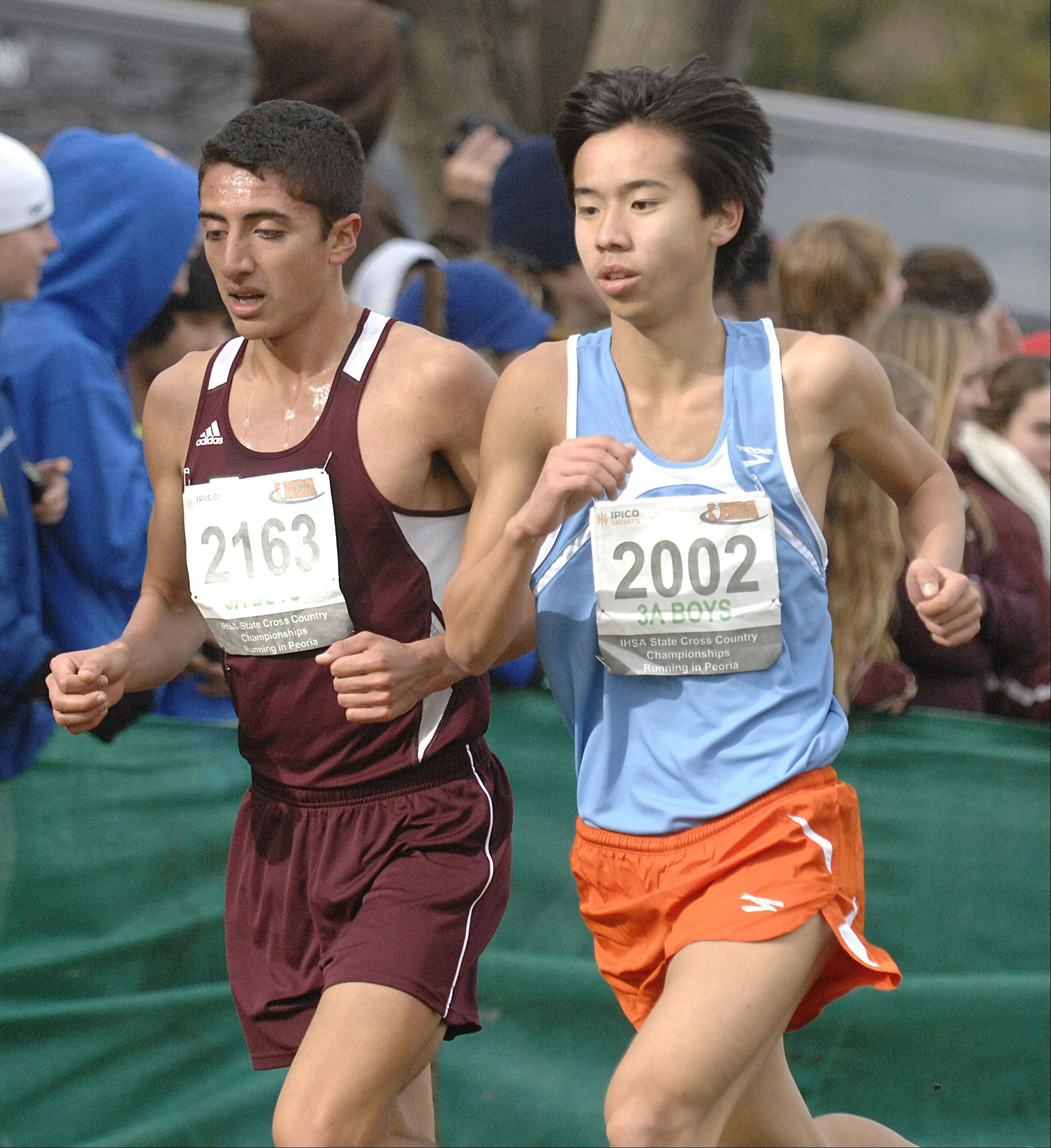 Berwyn-Cicero's Omero Montalvo and Naperville North's Jimmy Qiao in the state cross country 3A final in Peoria on Saturday, November 3.