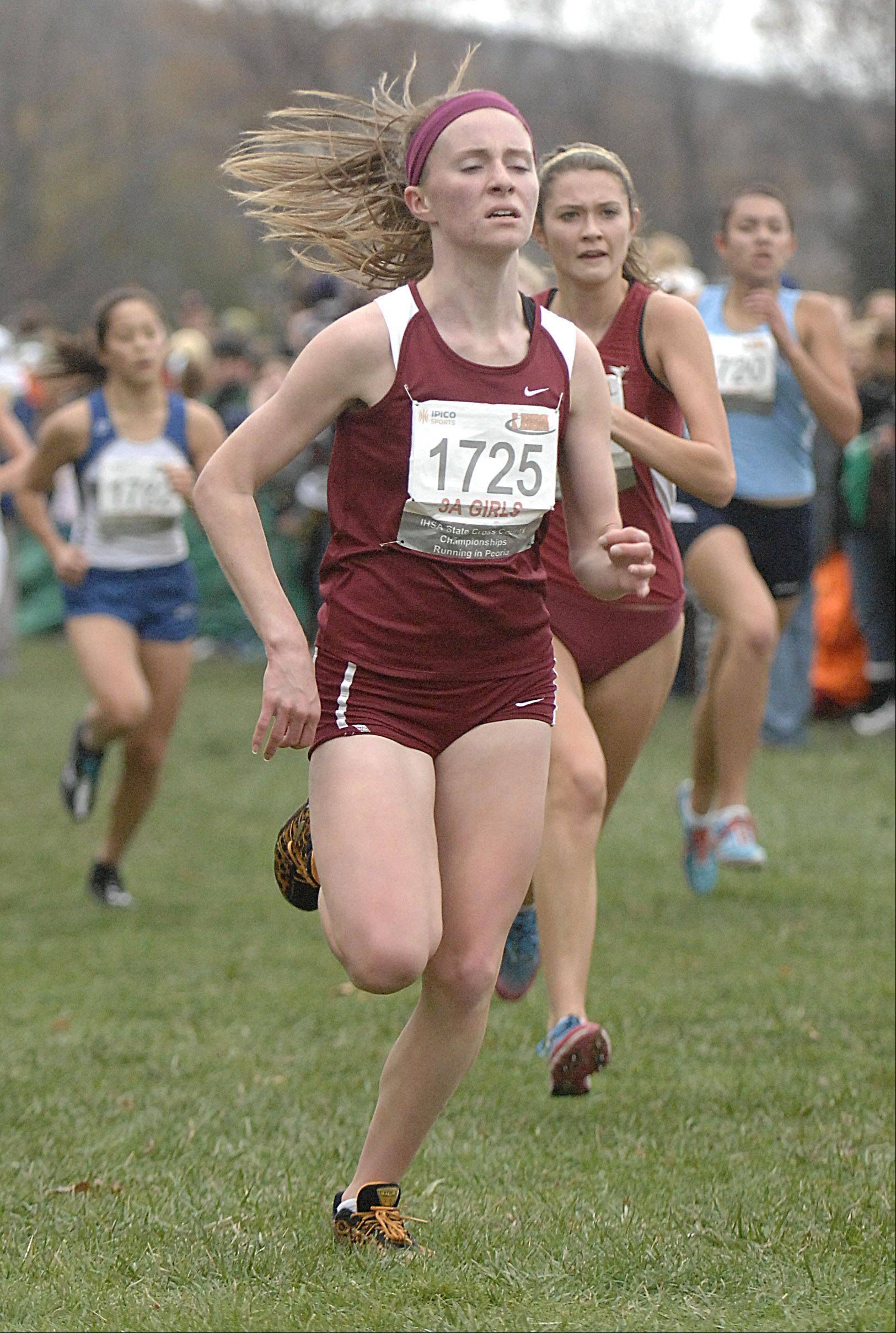 Schaumburg's Ali Gutt approaches the finish line in the state cross country 3A final in Peoria on Saturday, November 3.