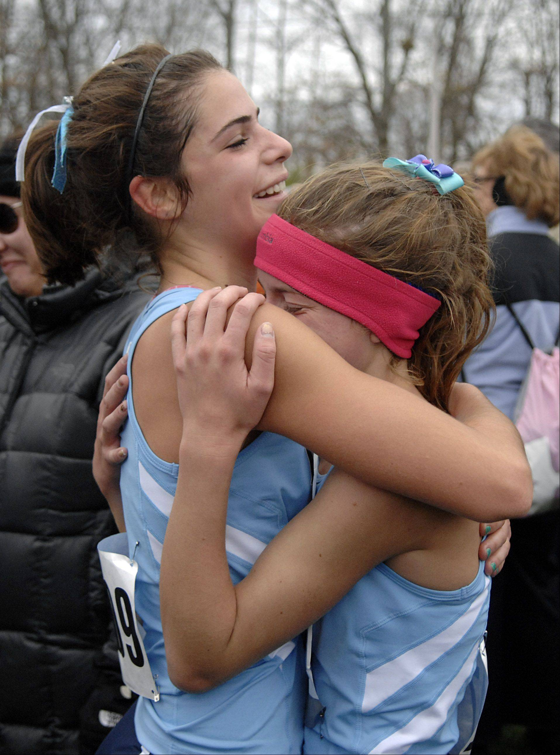 Lake Park's Nicole Alfano, left, and Samantha Montalbaldo embrace after learning their team took second place in the 3A state cross country final in Peoria on Saturday, November 3.