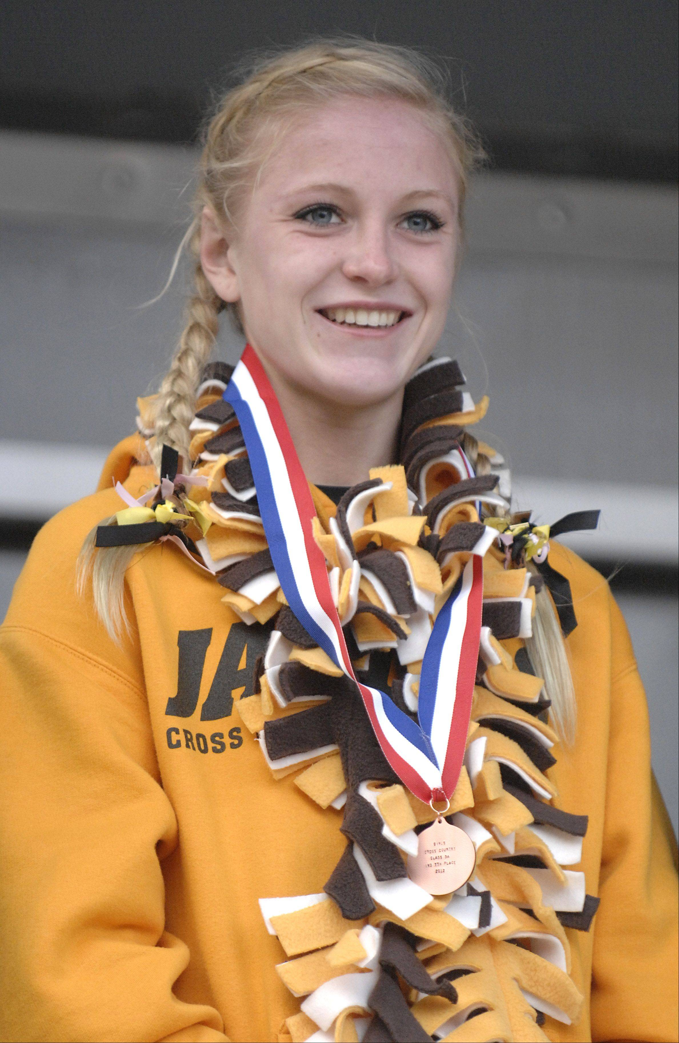 Jacobs' Lauren Van Vlierbergen and her 3A seventh place medal at the cross country state finals in Peoria on Saturday, November 3.