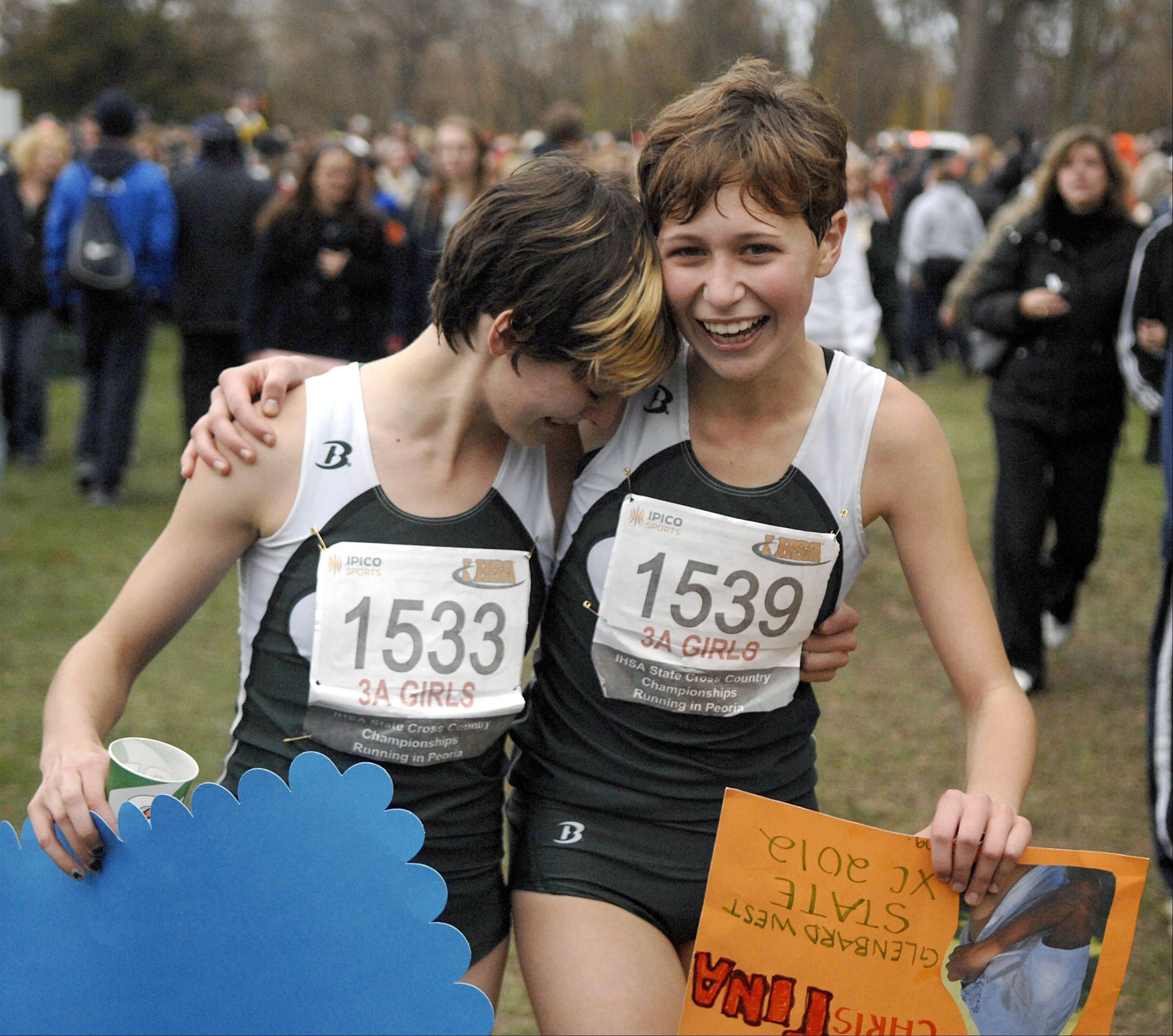 Glenbard South's Cynthia Mote and Christina Sedall embrace as they make their way back to their tent after learning of their team's third place win in the state 3A cross country final in Peoria on Saturday, November 3. It's also Mote's 18th birthday.