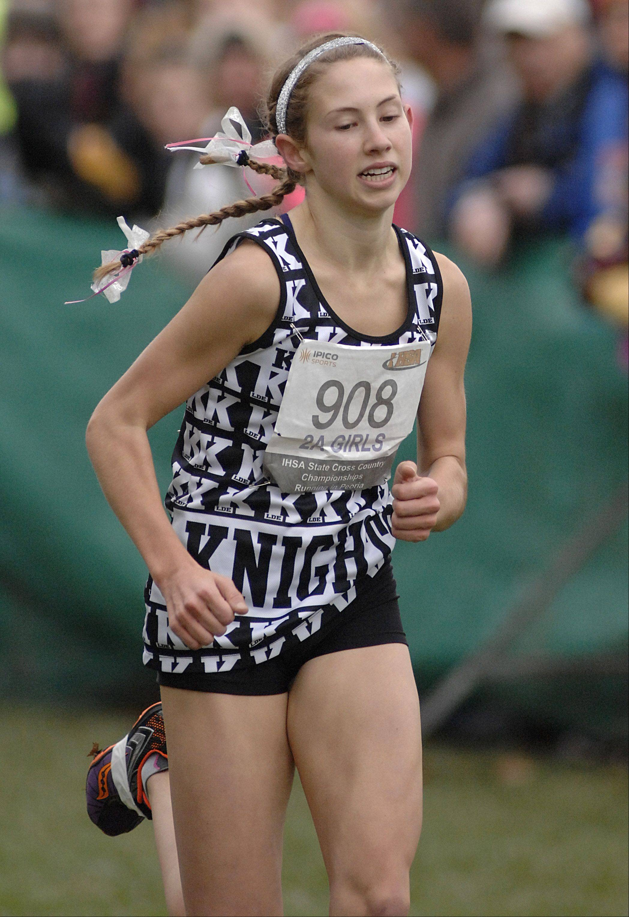 Kaneland's Victoria Clinton approaches the finish line in the state cross country 2A final to take first place in Peoria on Saturday, November 3.