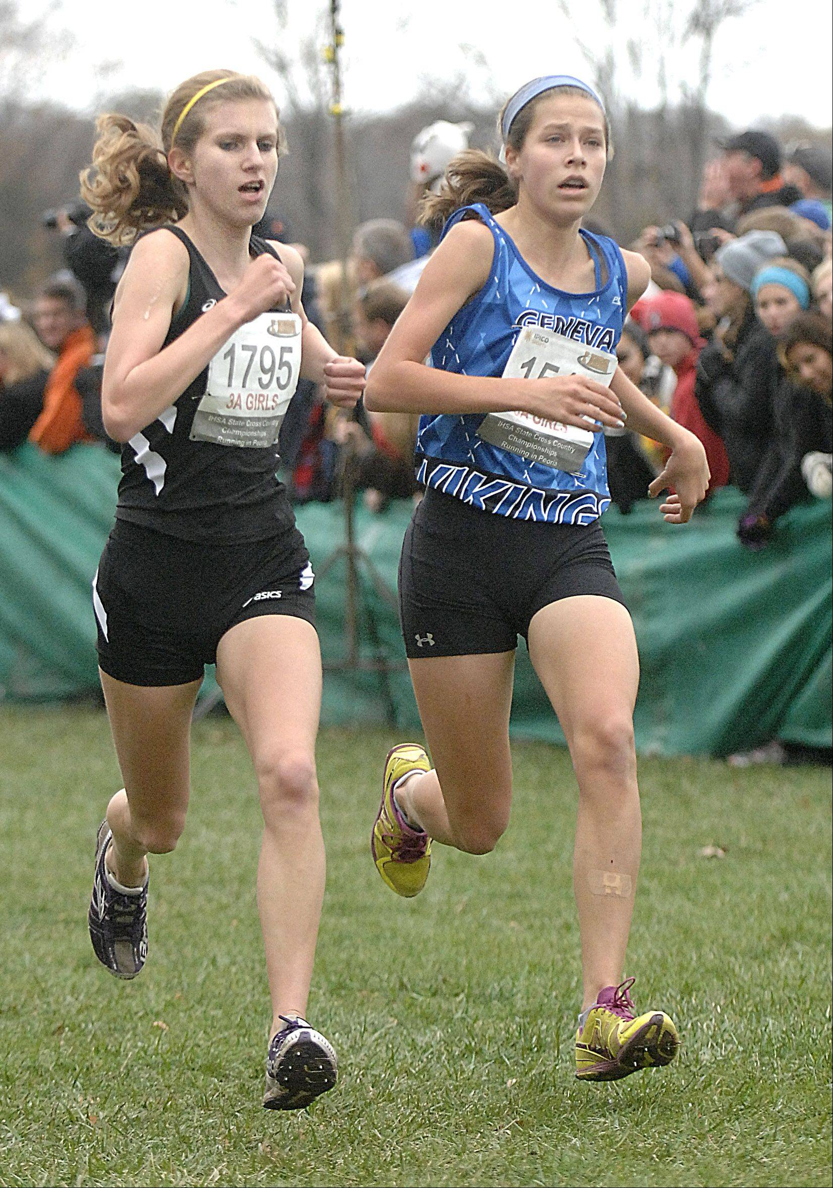 Metea Valley's Kendall Cast and Geneva's McKenzie Altmayer battle to the finish line in the state cross country 3A final in Peoria on Saturday, November 3. Girls took 38th and 36th place respectively.