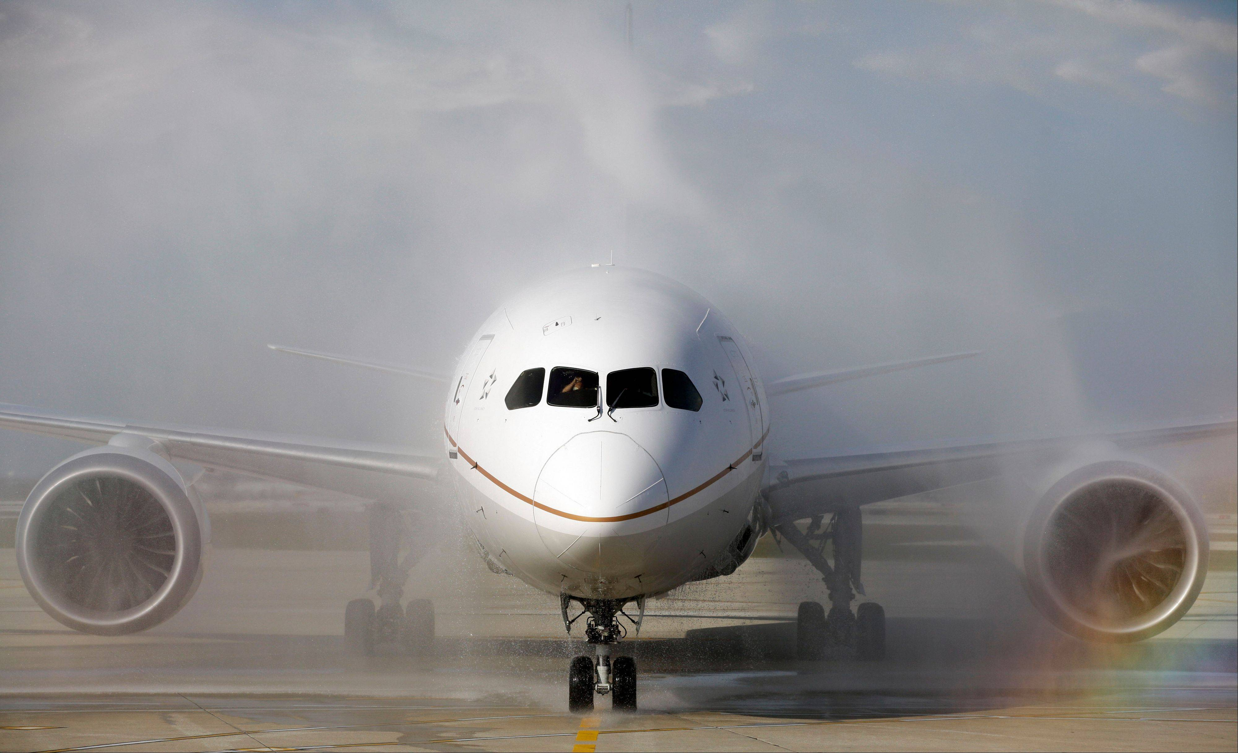 ASSOCIATED PRESS A United Airlines 787 Dreamliner receives a ceremonial wash as it arrives at O�Hare international Airport in Chicago Sunday from Houston after making United�s inaugural 787 revenue flight. The aircraft is touted to be much more fuel efficient than any other similar plane and has a host of passenger amenities, such as larger windows, special lighting and filtered air.
