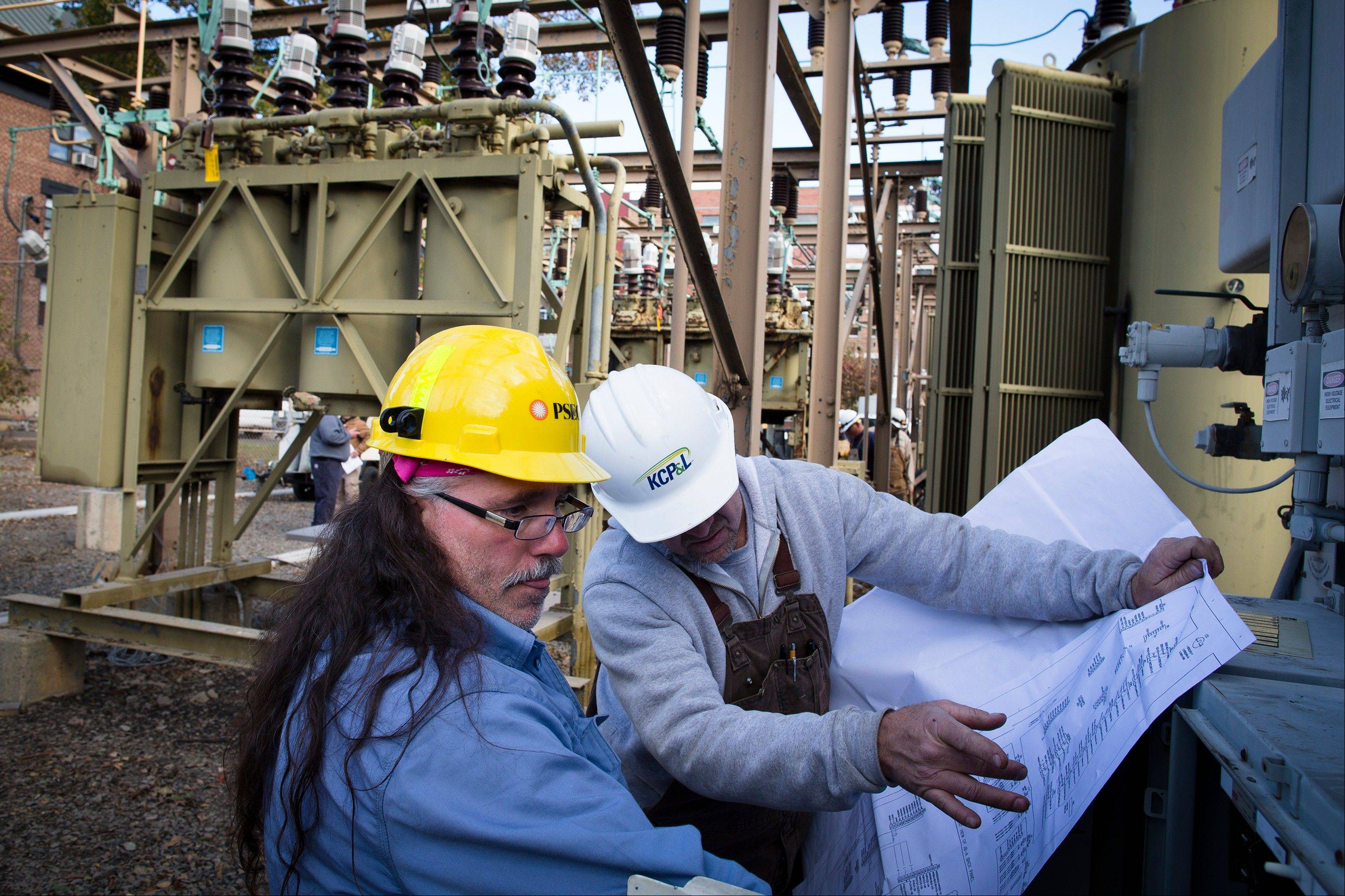 Workers inspect a transformer box at a substation on Harrison and 2nd Street as surrounding neighborhoods remain without power due to damage caused by Superstorm Sandy on Sundayin Hoboken, N.J. Hiring in the long-depressed U.S. construction industry will likely get a boost from the rebuilding that will follow Superstorm Sandy.