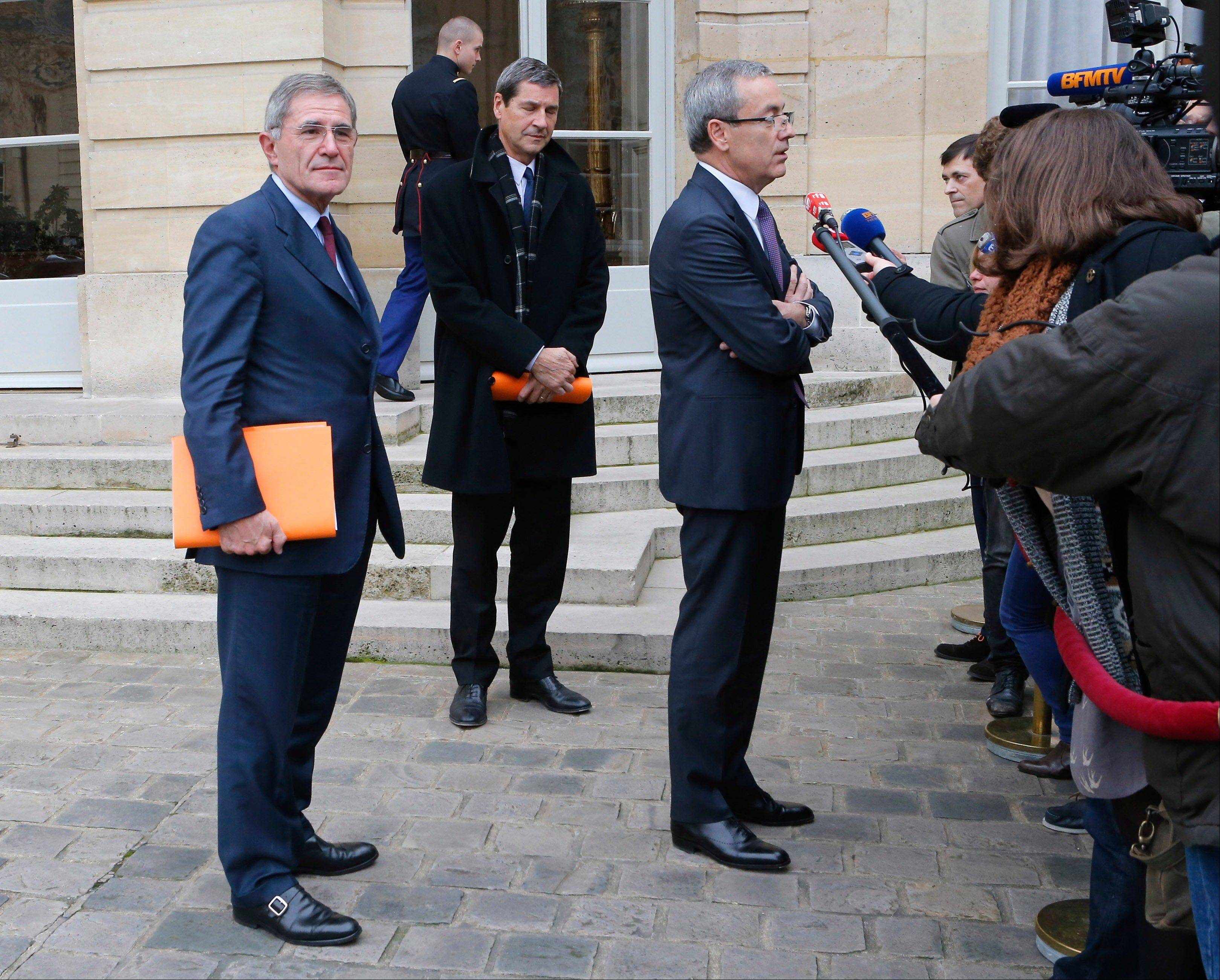 Chief Executive Officer of Solvay Jean Pierre Clamadieu, right, GDF Suez Chief Executive, Gerard Mestrallet, left, and Chief Executive of Imerys Gilles Michel, react with media after their meeting with French Prime Minister Jean Marc Ayrault, unseen, in the Matignon Palace in Paris Monday. The French government is hoping that gradual change is the way to go, and that a series of private meetings and cautious public statements in recent days will mollify both fearful workers and employers who say it's no longer worth the cost to hire. That failed to keep unemployment from rising, or some of France's biggest corporations from announcing thousands more layoffs, including carmaker Peugeot Citroen, Air France and retail giant Carrefour.