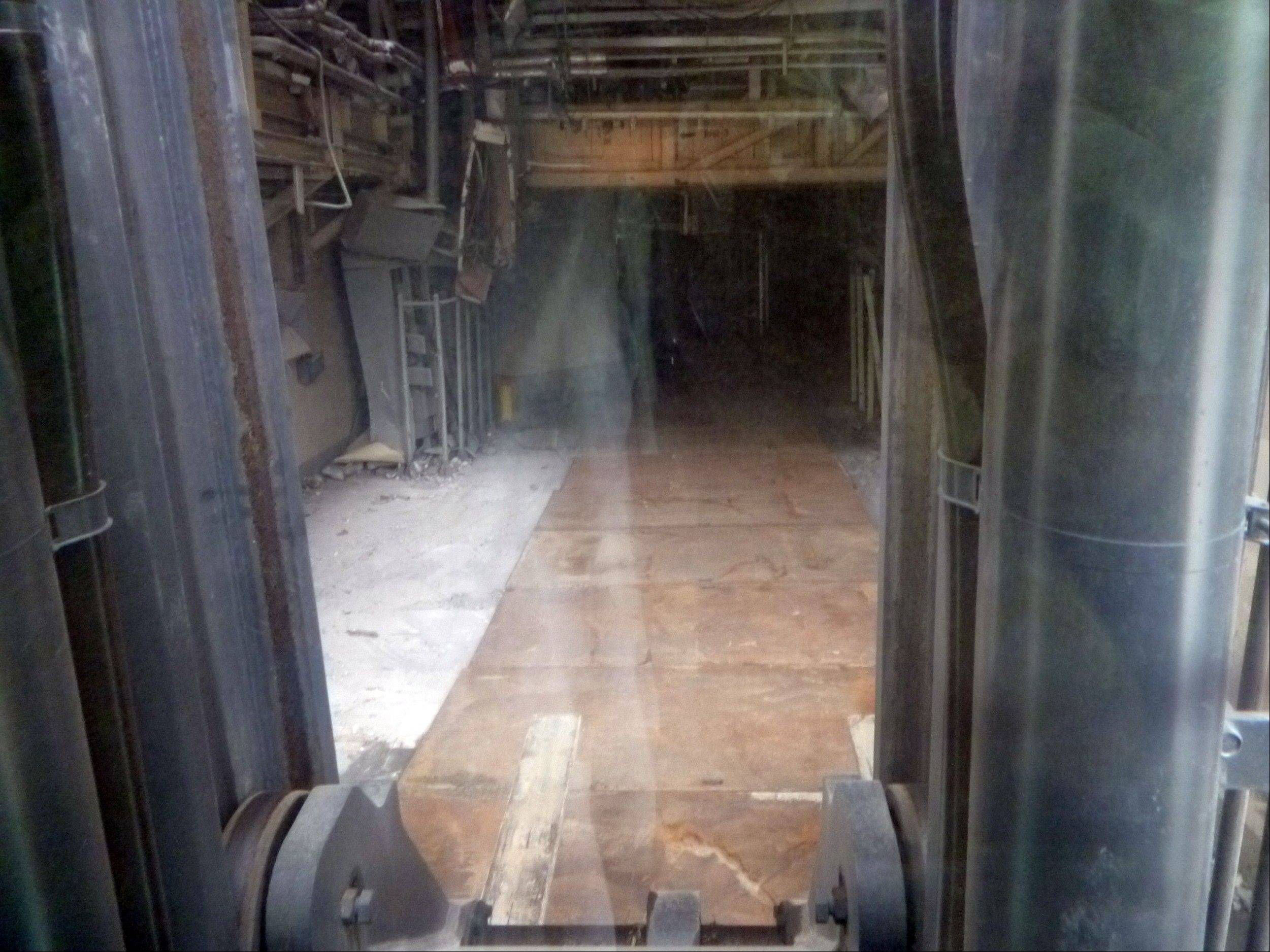 This July 3, 2011, photo released by Tokyo Electric Power Co. (TEPCO), taken through a window of a fork lift, shows iron sheets which protect workers from radiation on the ground floor of the Unit 3 reactor building at the tsunami-crippled Fukushima Dai-ichi nuclear power plant in Okuma town, Fukushima Prefecture, northeastern Japan. The operator of a Japanese nuclear plant that went into a tsunami-triggered meltdown knew the risks from highly radioactive water at the site but sent in crews without adequate protection or warnings, a worker said in a legal complaint filed Tuesday, Oct. 31, 2012. Asked about the allegations, a TEPCO spokesman said the plant was aware of water leaks elsewhere but couldn�t anticipate the water problem in Unit 3�s basement.