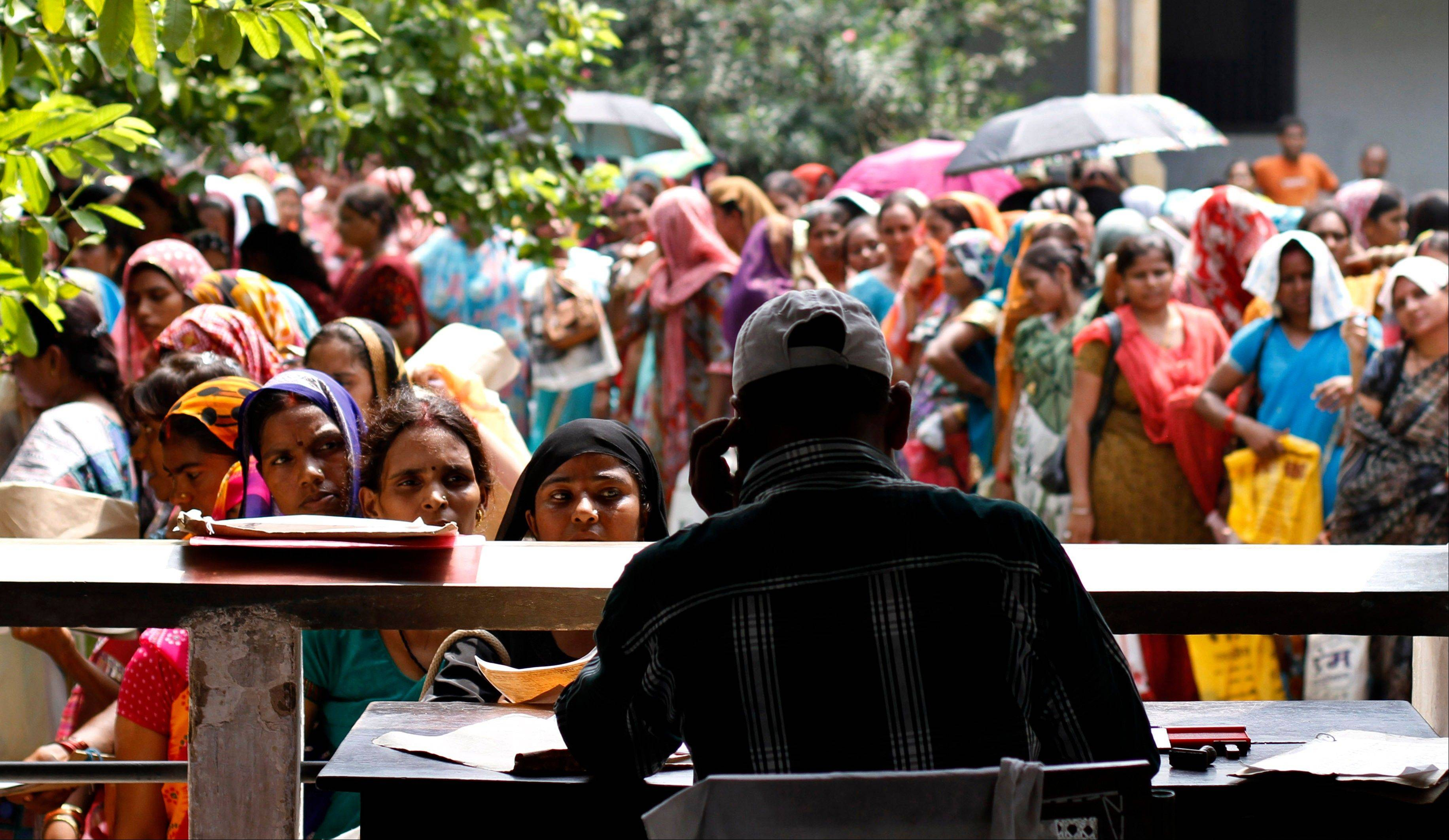 Unemployed educated Indian women stand in queues to register themselves at the Employment Exchange Office in Allahabad, India. India, with the world�s largest chunk of illiterates at over 250 million, has to invest heavily in education and skills training, said Ashish Bose, a leading demographer. While millions of jobseekers have impressive sounding diplomas, many don�t have the skills promised by those certificates from colleges and technical institutes with poor standards.