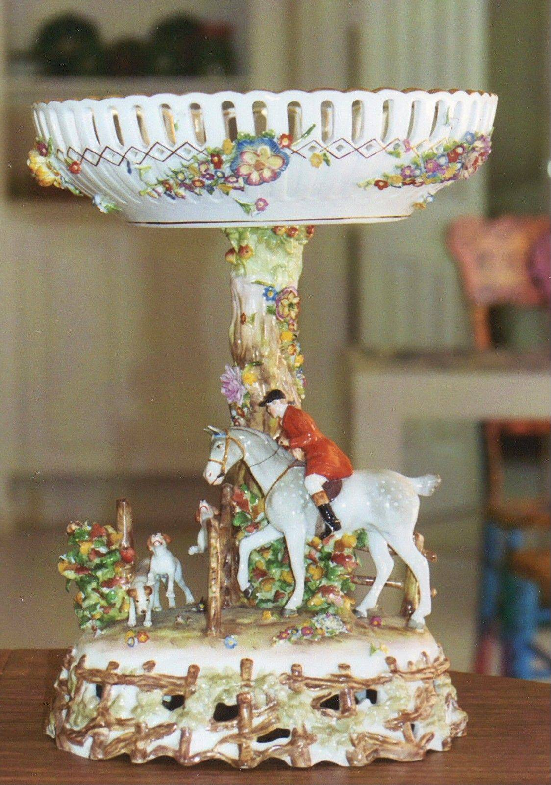 Any collector interested in German porcelain, or horse and hunting pieces, would be interested in this garniture set.
