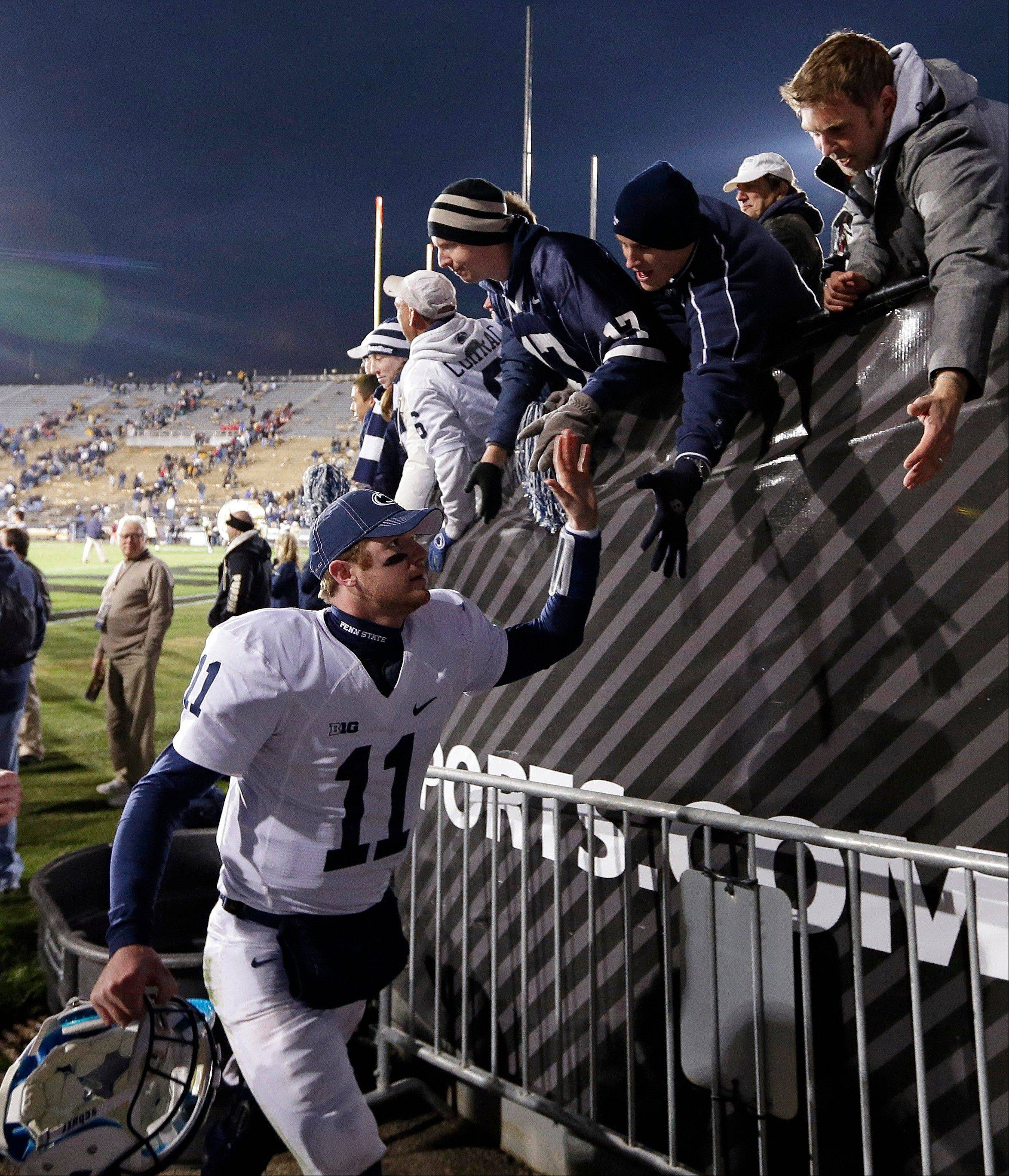 ASSOCIATED PRESS Penn State�s Matthew McGloin celebrates with fans after Penn State defeated Purdue, 34-9, Saturday in West Lafayette, Ind. The football team has faced unprecedented penalties in the wake of the Jerry Sandusky scandal.