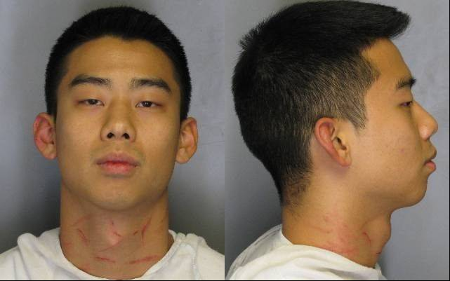 Daniel Chang, 22 of Naperville, was arrested on weapons charges by Champaign police early Sunday morning.
