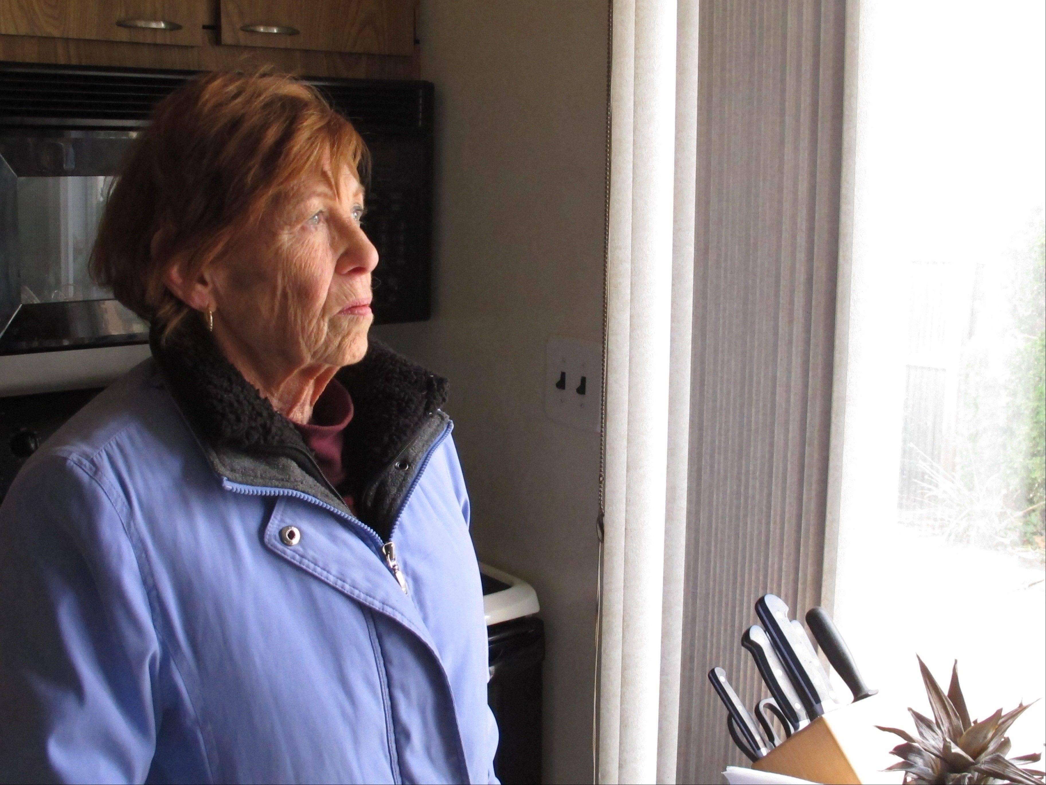 Eileen James wears layered clothing and stays close to the windows in the daytime to try and stay warm in Farmingdale, N.Y. The 78-year-old retired secretary is one of thousands of elderly people coping with no electricity or heat in the wake of Superstorm Sandy.
