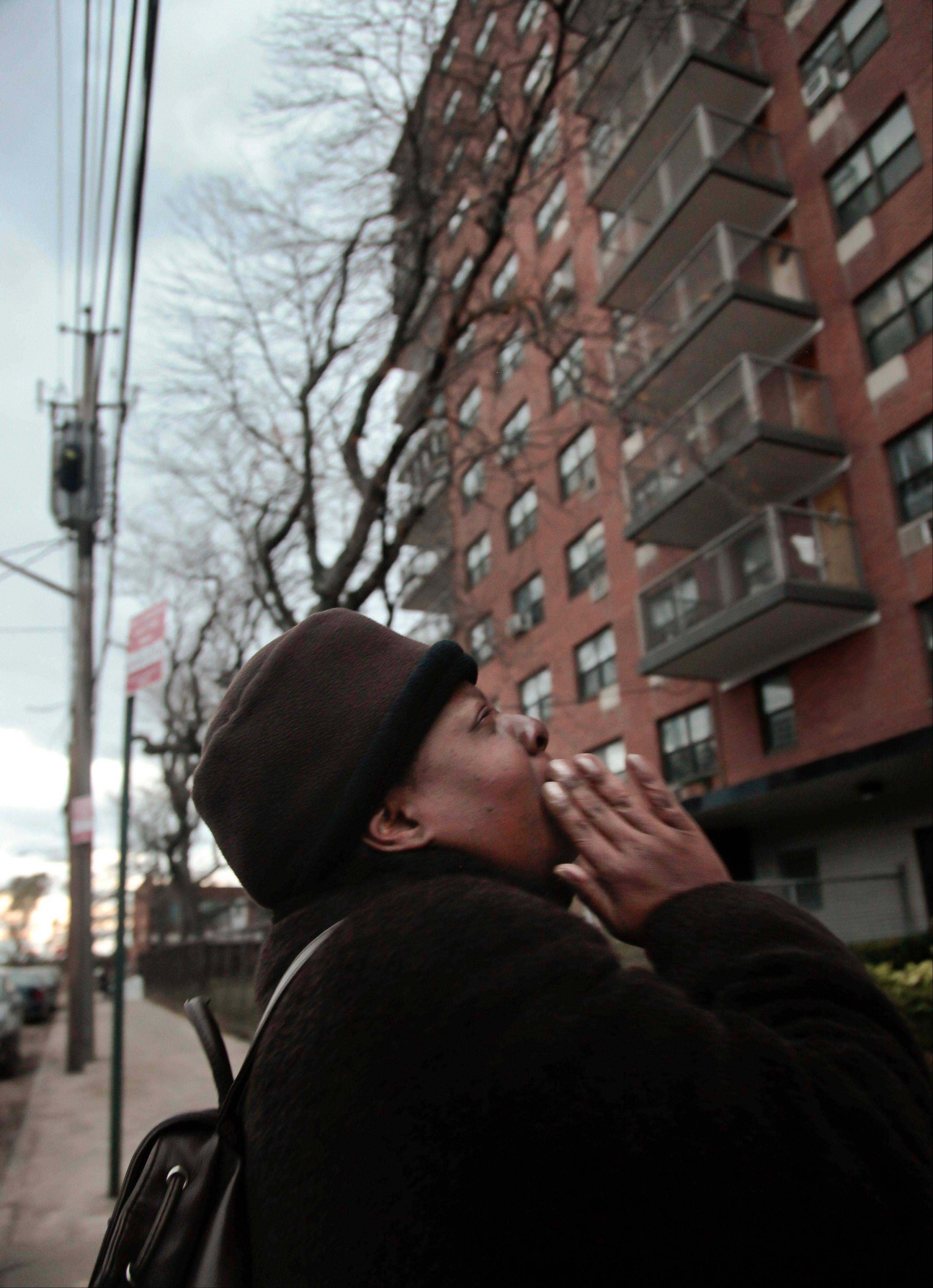 Roxanne Boothe stands outside the Sam Burt Houses, where she is president of the tenants association, and shouts that �we have hot food� to alert residents of a donation of food on Saturday in Coney Island, N.Y. The complex, which has been without power since Monday, flooded during superstorm Sandy. �We have no heat, no water, no electricity, it�s dark in the whole building,� said Boothe.