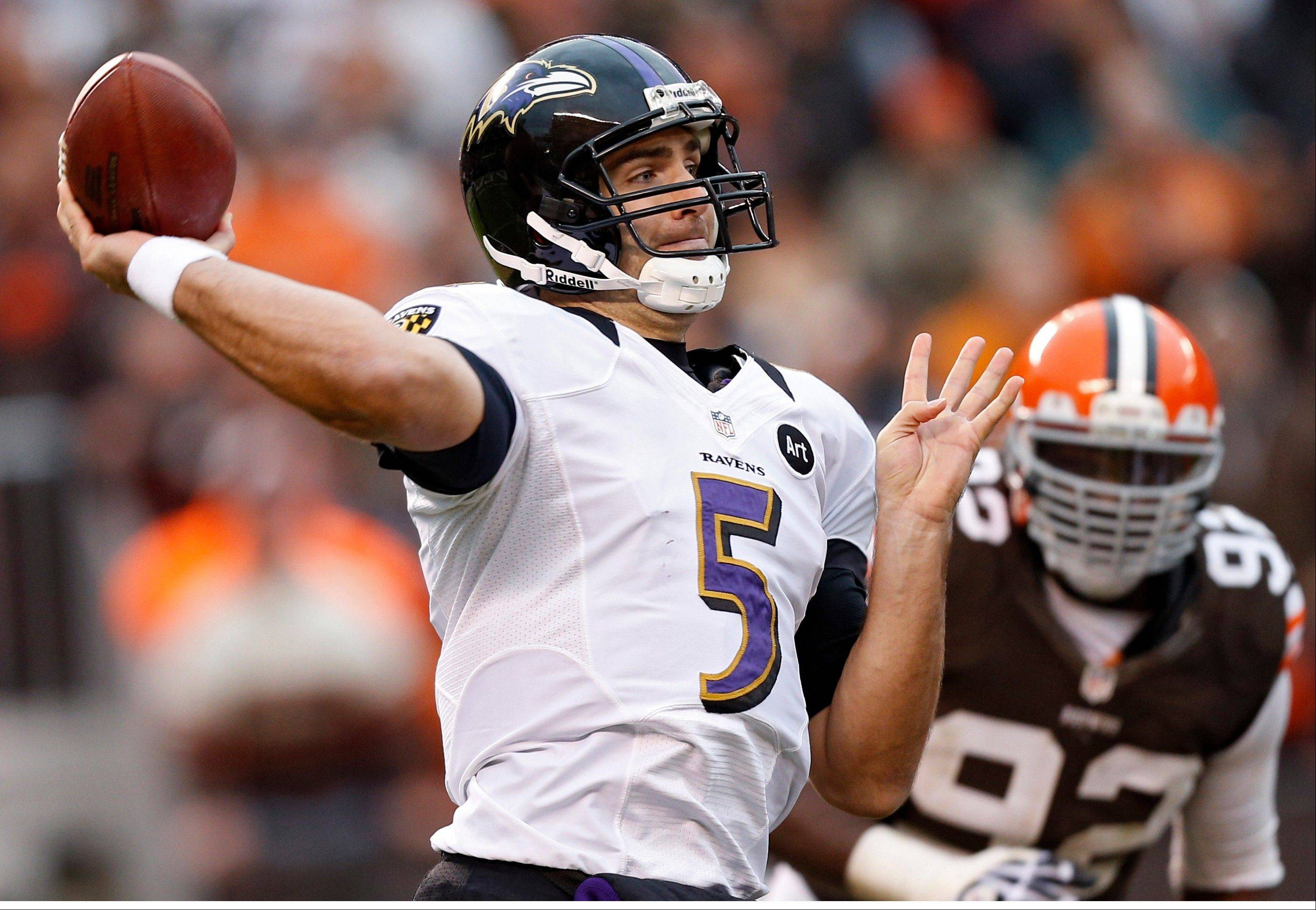 Baltimore Ravens quarterback Joe Flacco passes against the Cleveland Browns in the fourth quarter Sunday in Cleveland.