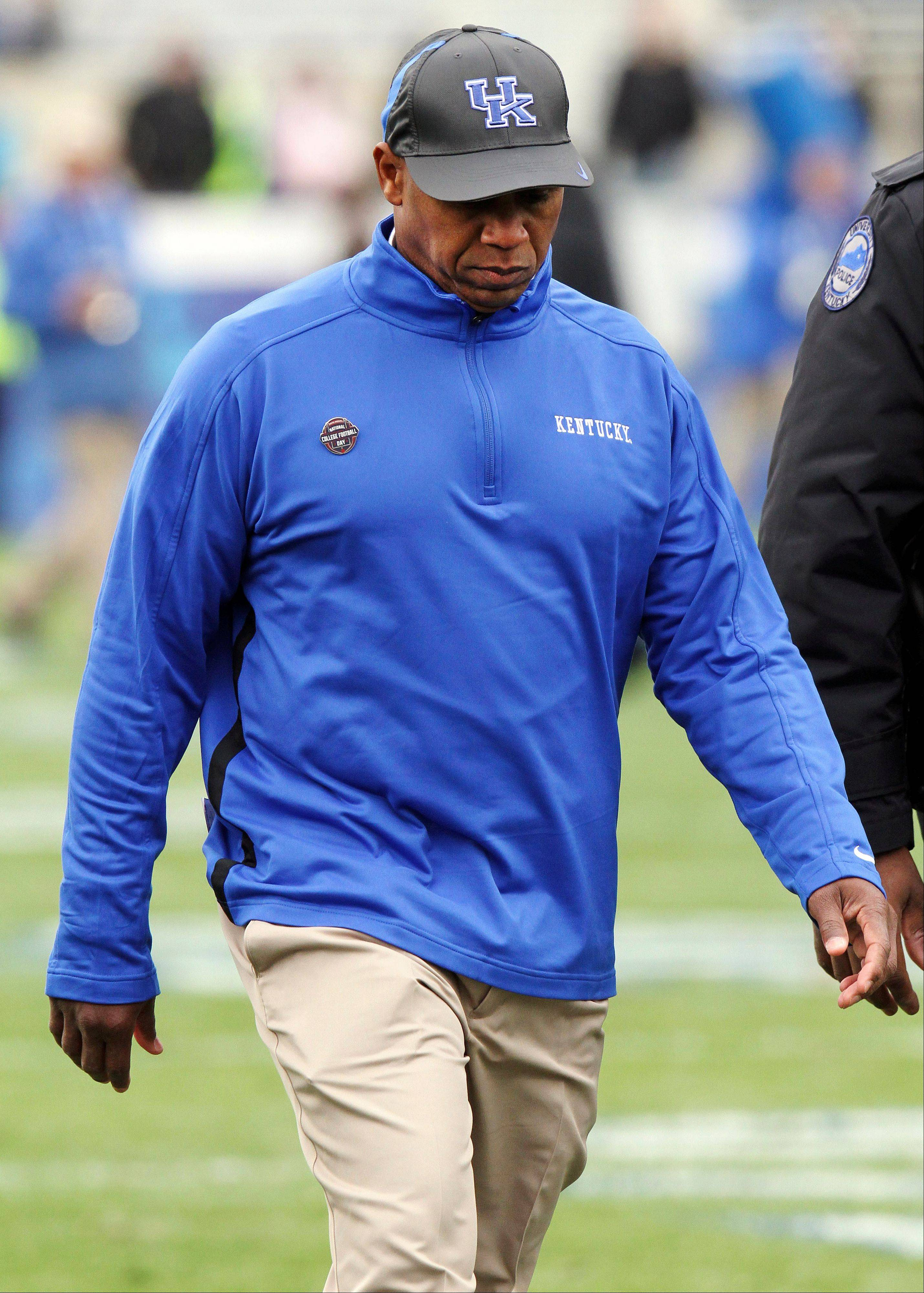 Kentucky head coach Joker Phillips walks off the field after his team�s 40-0 loss to Vanderbilt on Saturday at Commonwealth Stadium in Lexington, Ky. Phillips was fired Sunday.