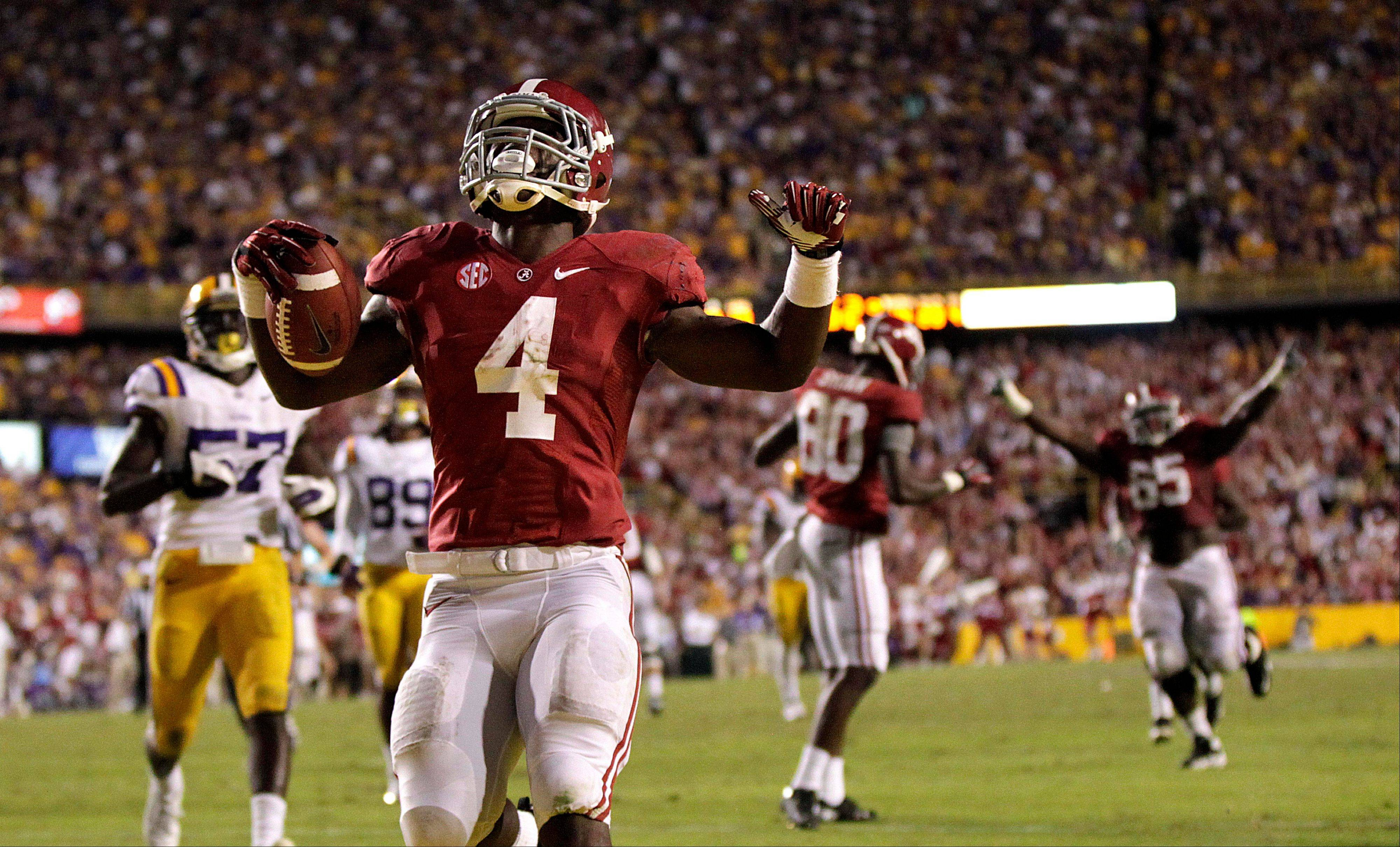 Alabama running back T.J. Yeldon scores the game winning touchdown past LSU defensive end Barkevious Mingo Saturday in the fourth quarter in Baton Rouge, La. Alabama won 21-17.