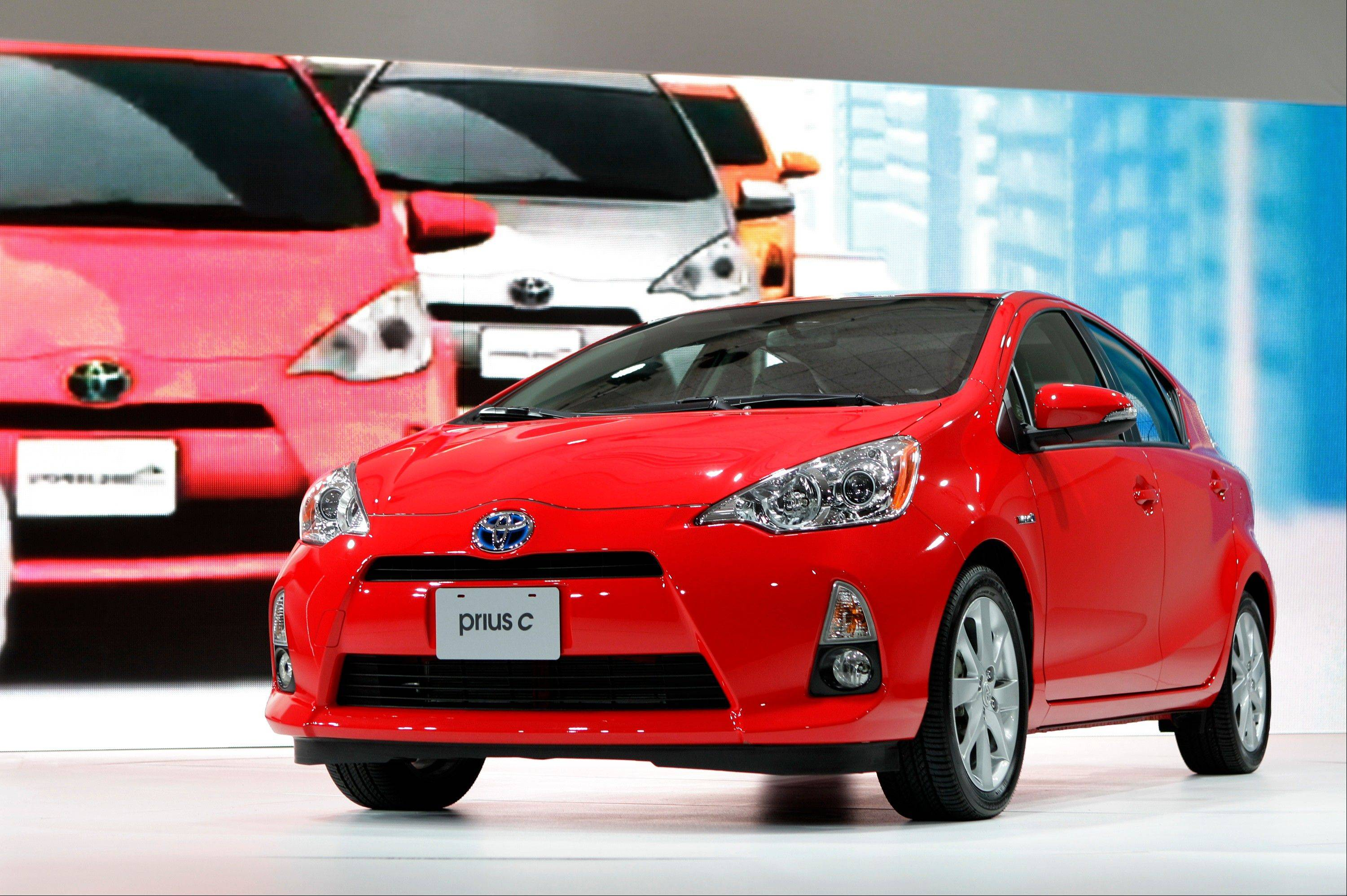 The 2013 Toyota Prius c is seen during its debut at the North American International Auto Show in Detroit last winter. Toyota is pushing to broaden the popular hybrid car's appeal.