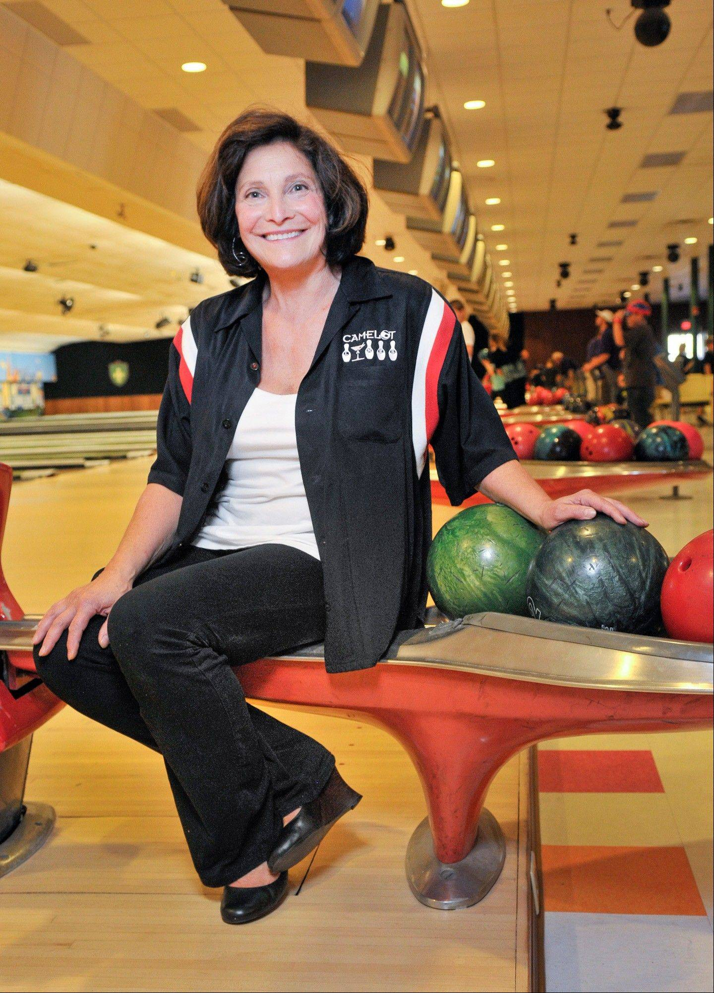 "Owner Peppe Smith stands in her bowling alley owner in Boardman, Ohio. Smith credits the resurgence in the area to a natural gas-drilling boom that could create tens of thousands of jobs and bring billions of dollars in investments. Crews involved in the natural gas exploration are boosting her business, along with workers from the nearby General Motors' Lordstown plant, a major beneficiary of the auto bailout. Despite the bailout's benefits, Smith is no fan. Ford, she says, handled its own financial troubles on its own. ""It makes you want to buy a Ford,"" she says. ""GM should take care of its own problems."""