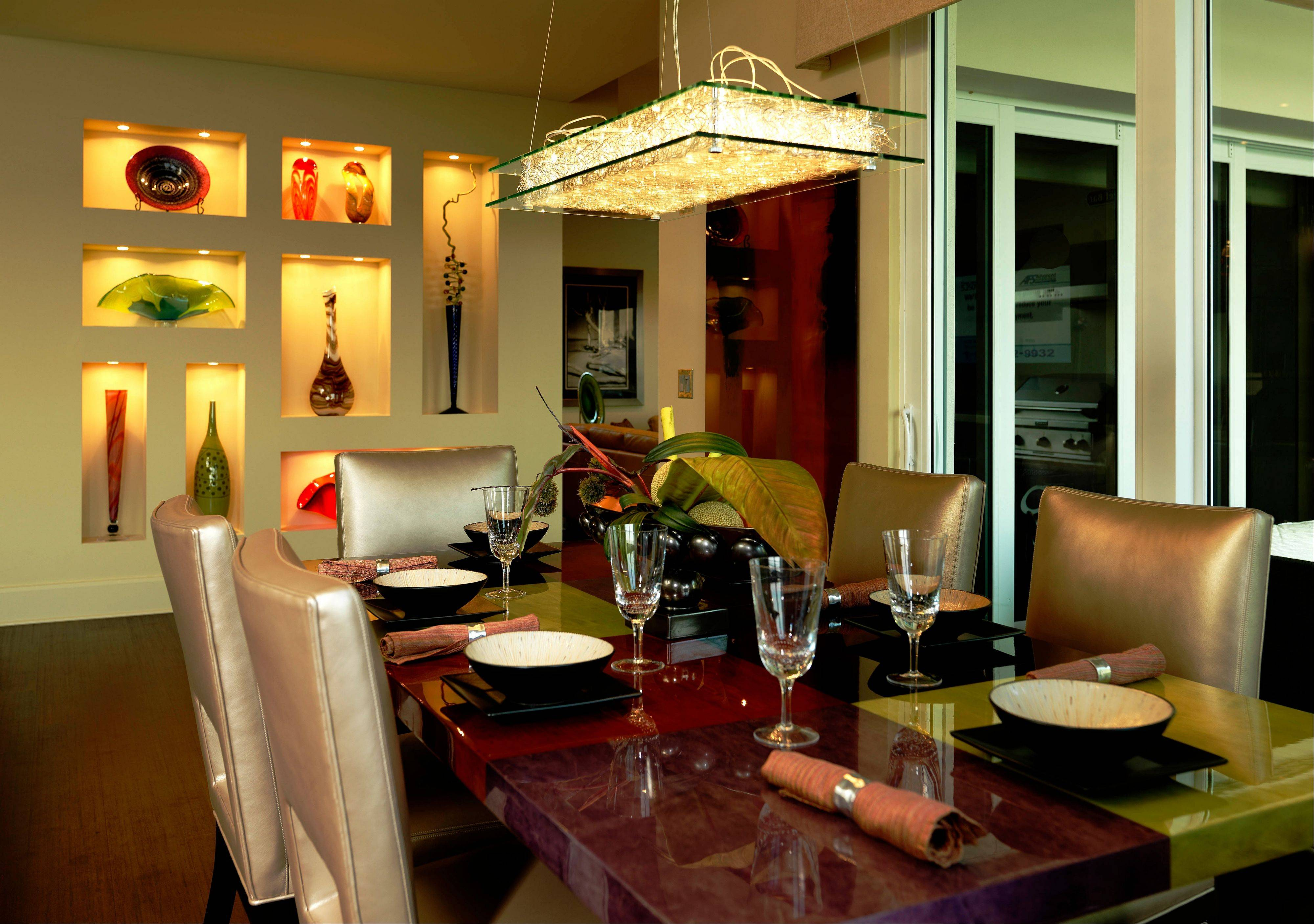 This glass, metal and exposed wire chandelier complements the rectangular shape of the custom dining room table.