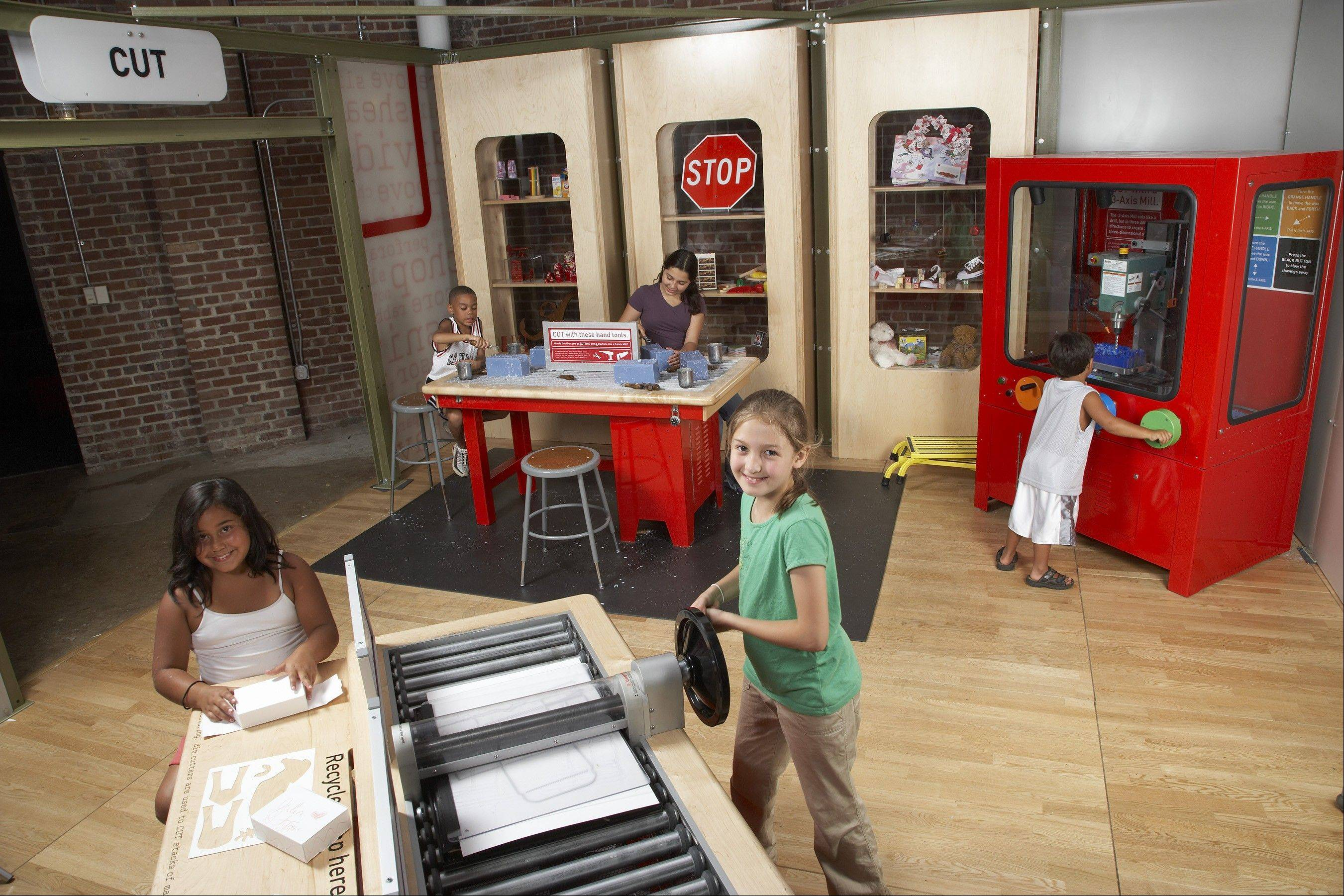 Students learn about cutting tools and materials used in the manufacturing process in the How People Make Things exhibit at the DuPage Children's Museum.