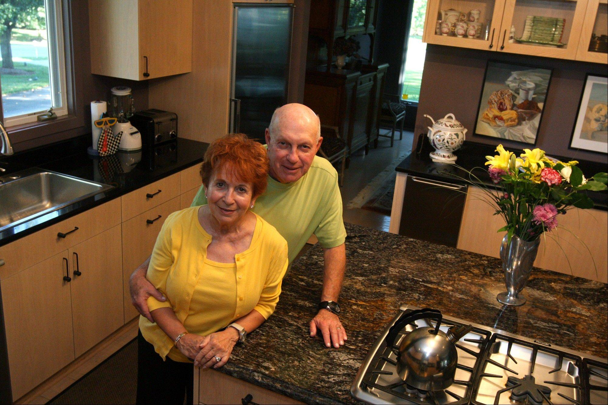 To reduce costs, Sherry and Joe Warsaw hired a carpenter to replace the doors of their kitchen cabinets; they spent about $11,000 for the woodworking.