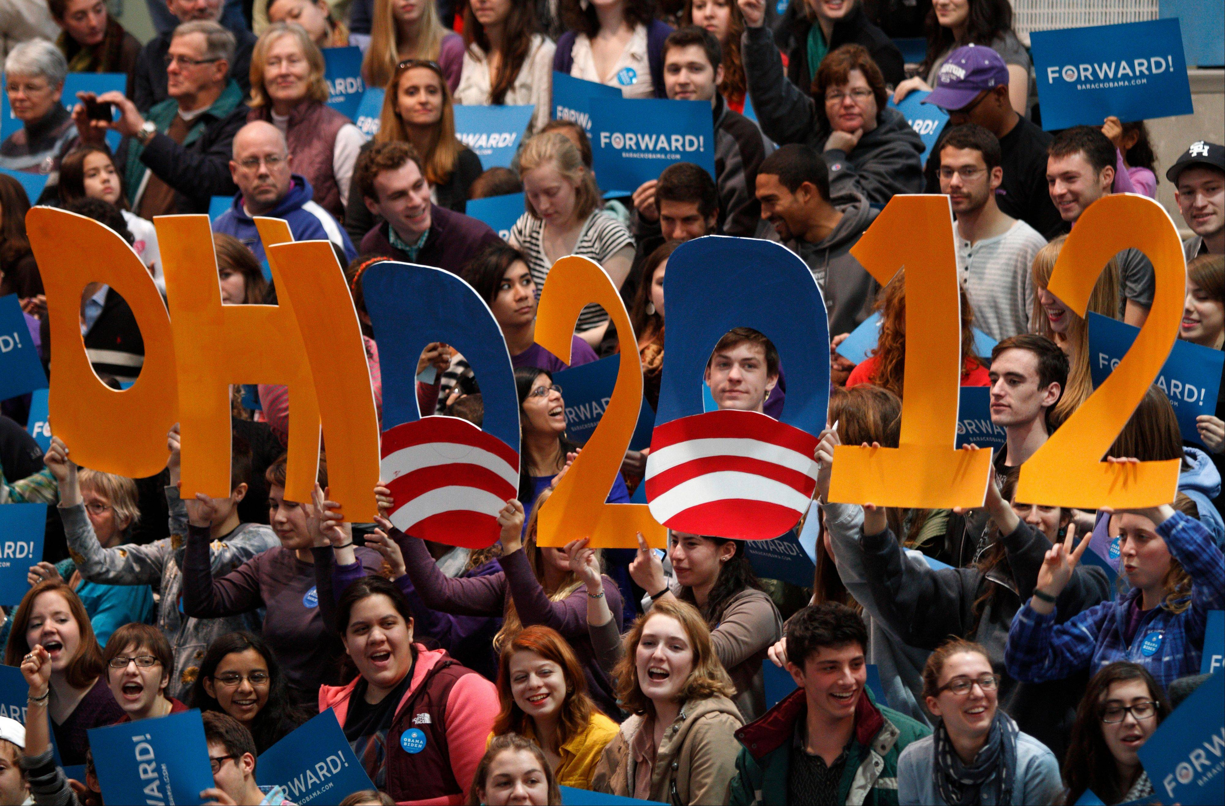 Supporters hold up a sign as they wait for first lady Michelle Obama to speak during a campaign rally for her husband, President Barack Obama, at Kenyon College in Gambier, Ohio, Saturday. In nearly elction-night scenarios, Ohio plays a pivotal role.