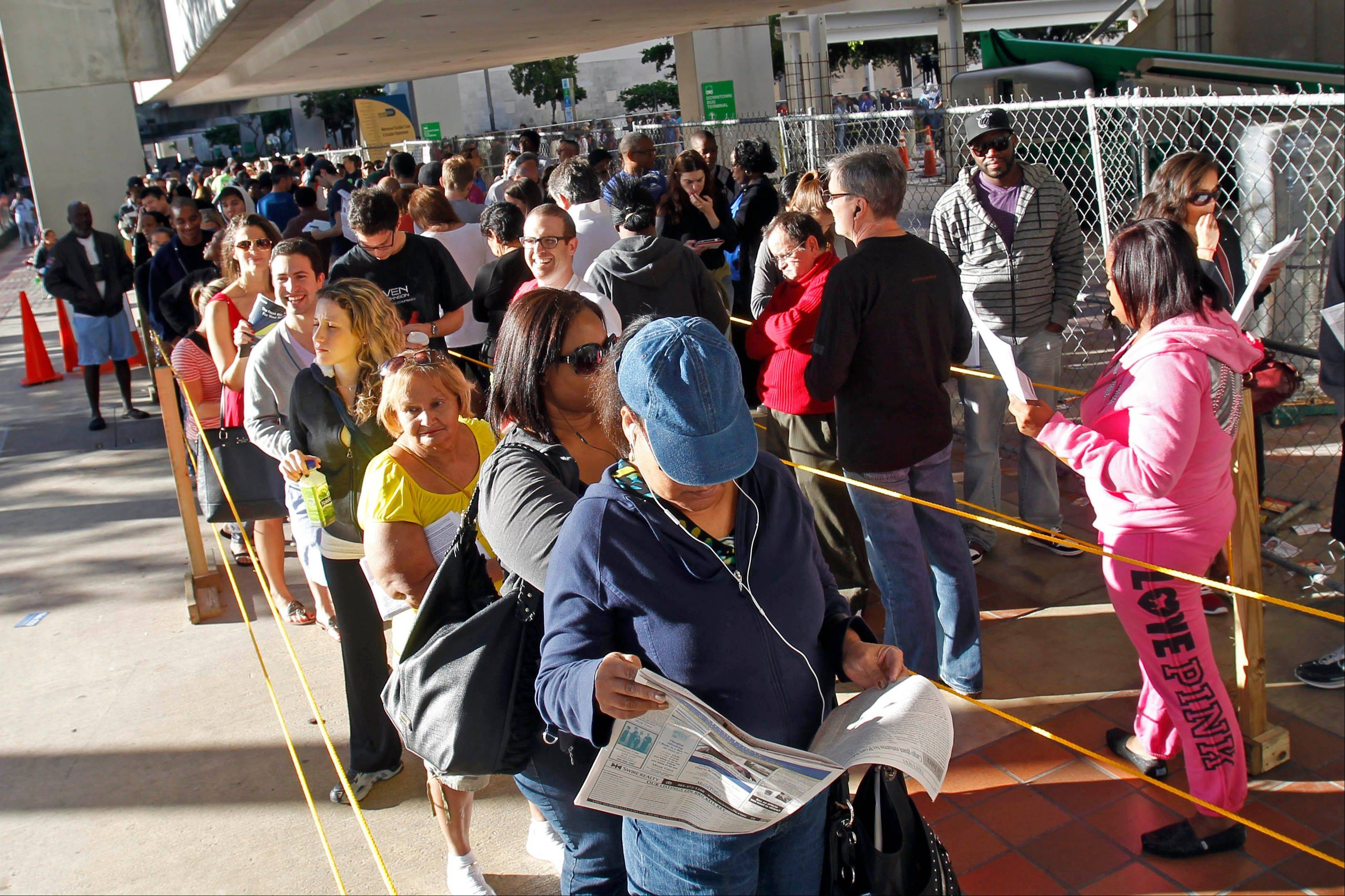 Floridians stand in line Sunday, the last day of early voting, in Miami. A judge extended early voting hours in one Florida county Sunday after Democrats sued to allow more time.